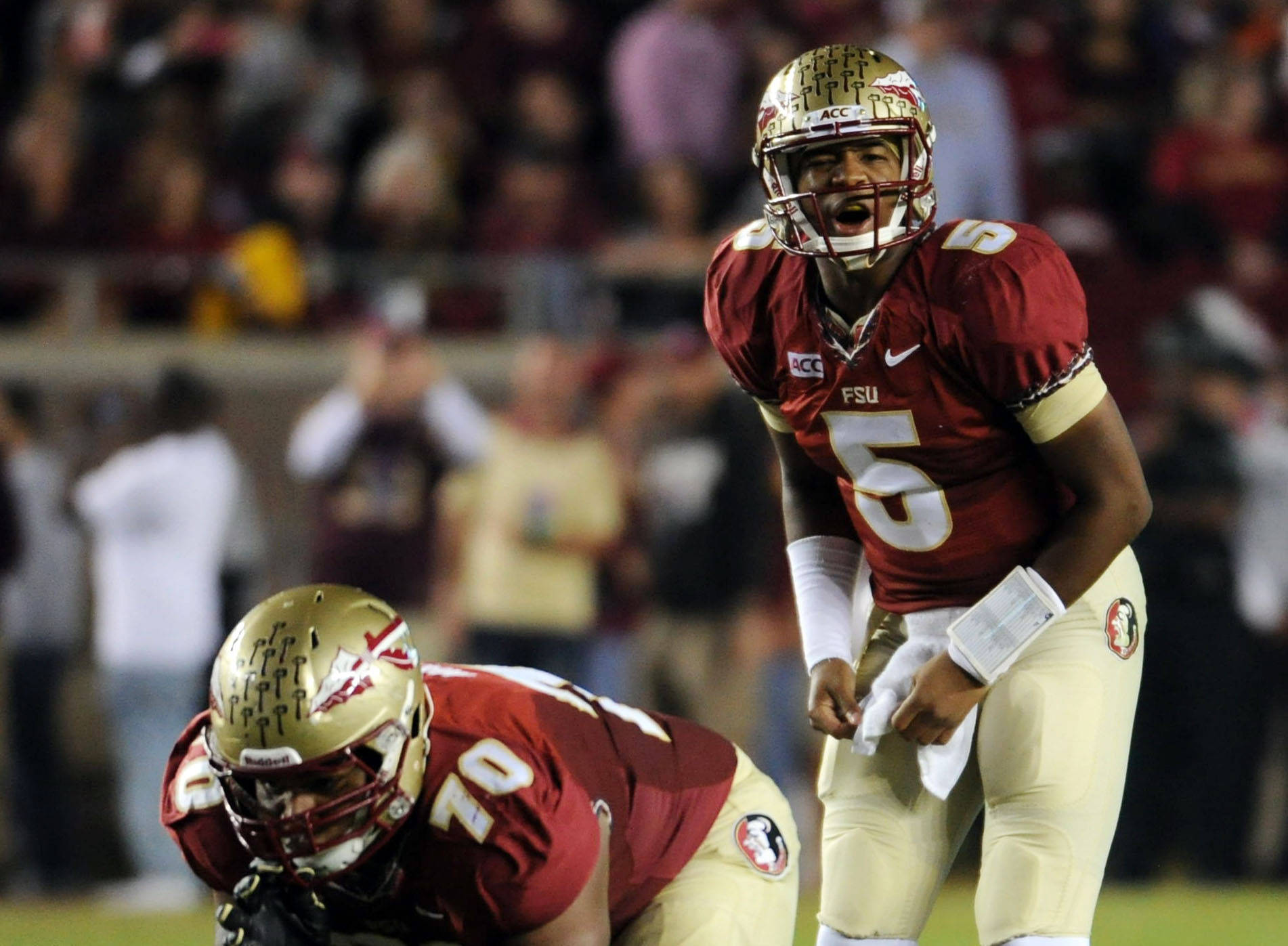 Florida State Seminoles quarterback Jameis Winston (5) prepares to take the snap from center Josue Matias (70) during the game against the Miami Hurricanes at Doak Campbell Stadium. Mandatory Credit: Melina Vastola-USA TODAY Sports