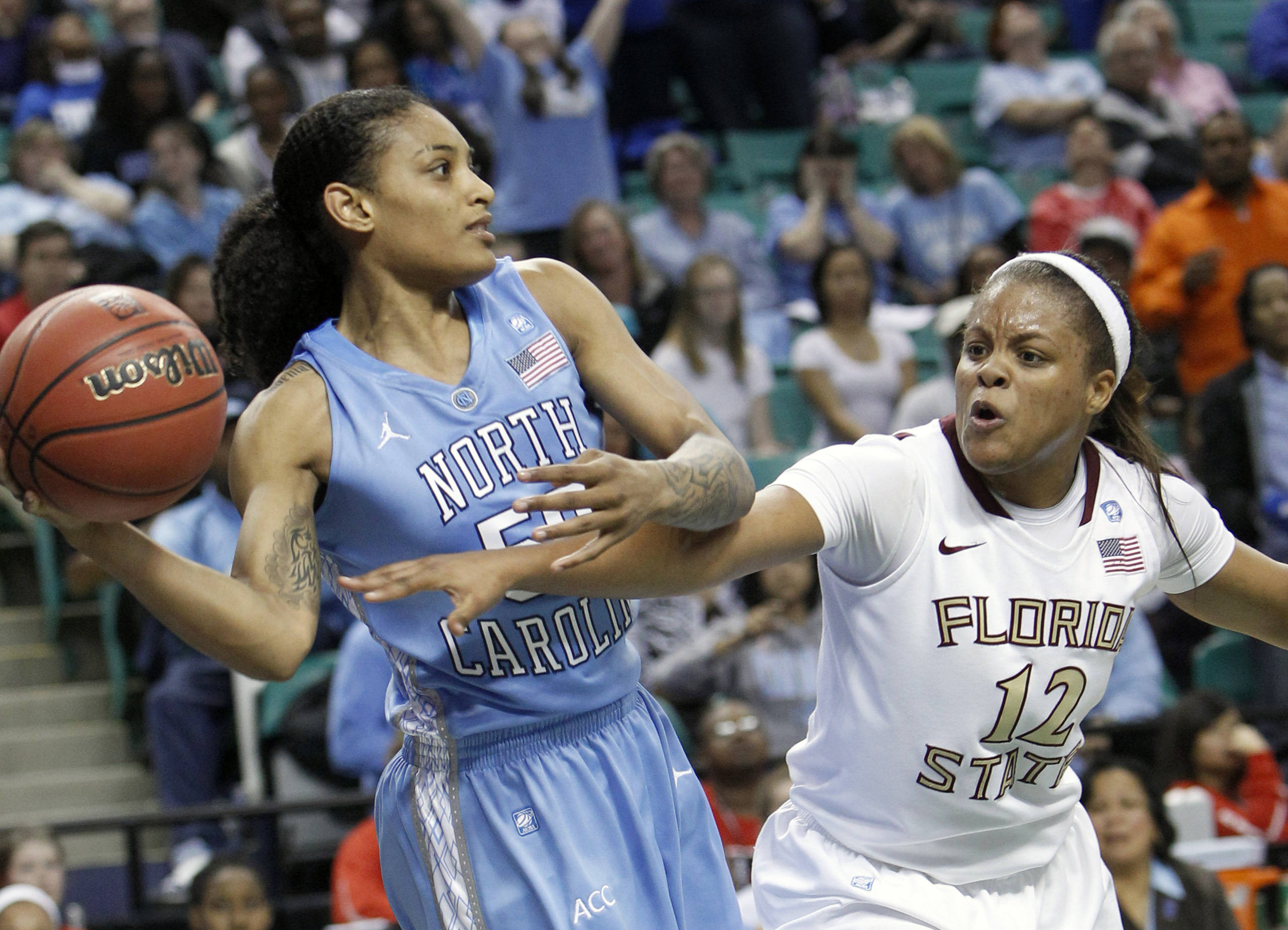 North Carolina's Italee Lucas keeps the ball from Florida State's Courtney Ward  in the second half. (AP Photo/Chuck Burton)