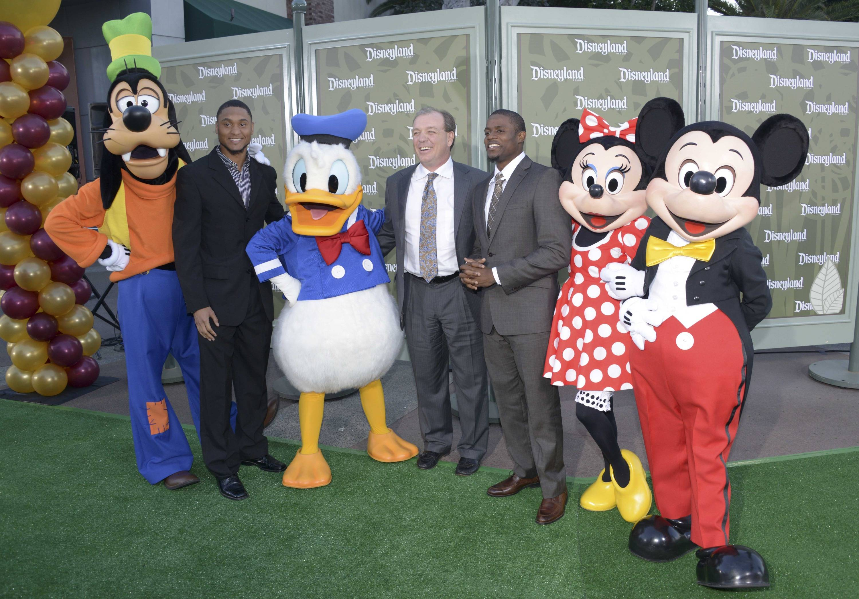 Florida State Seminoles players and coaches pose with Disney characters at a press conference for the 2014 BCS National Championship at ESPN Zone Downtown Disney. From left: Goofy, wide receiver Rashad Greene, Donald Duck, Jimbo Fisher, defensive back Lamarcus Joyner, Minnie Mouse and Mickey Mouse. Mandatory Credit: Kirby Lee-USA TODAY Sport
