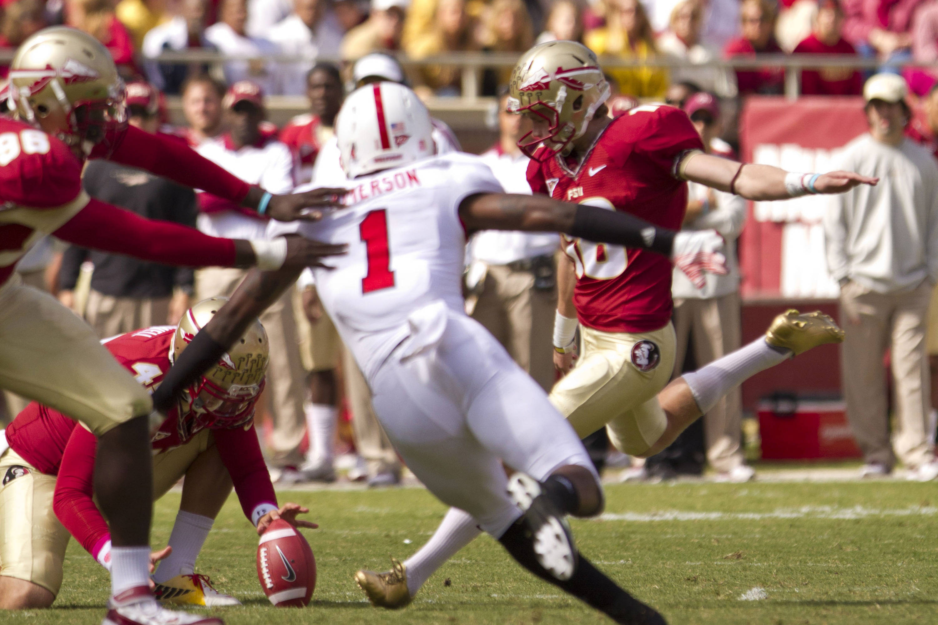 Dustin Hopkins (18) takes a kick during the football game against NC State on October 29, 2011.