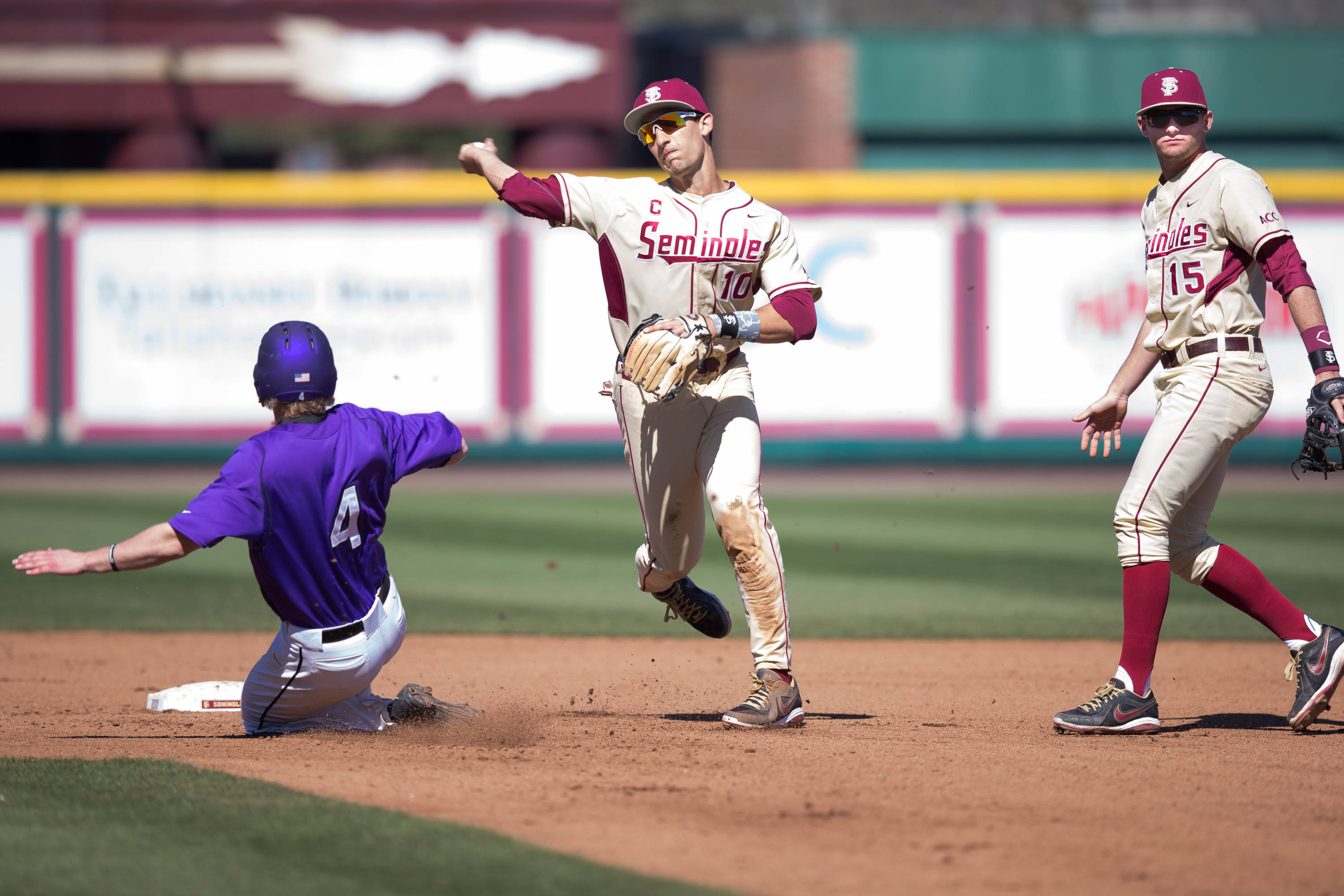 Justin Gonzalez (10) completes the double play after receiving the toss from second baseman Hank Truluck (15)