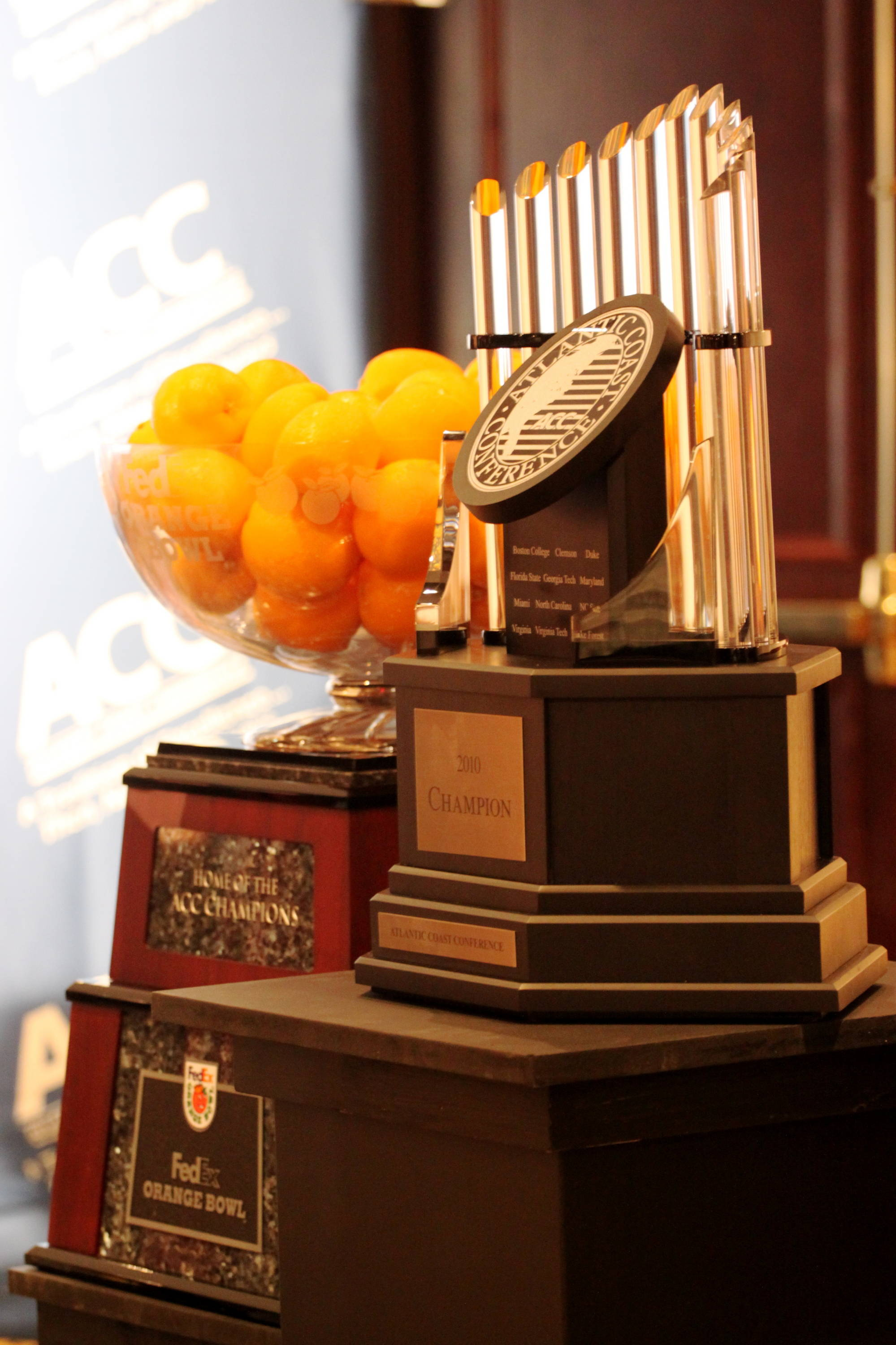 The ACC and Orange Bowl trophies.