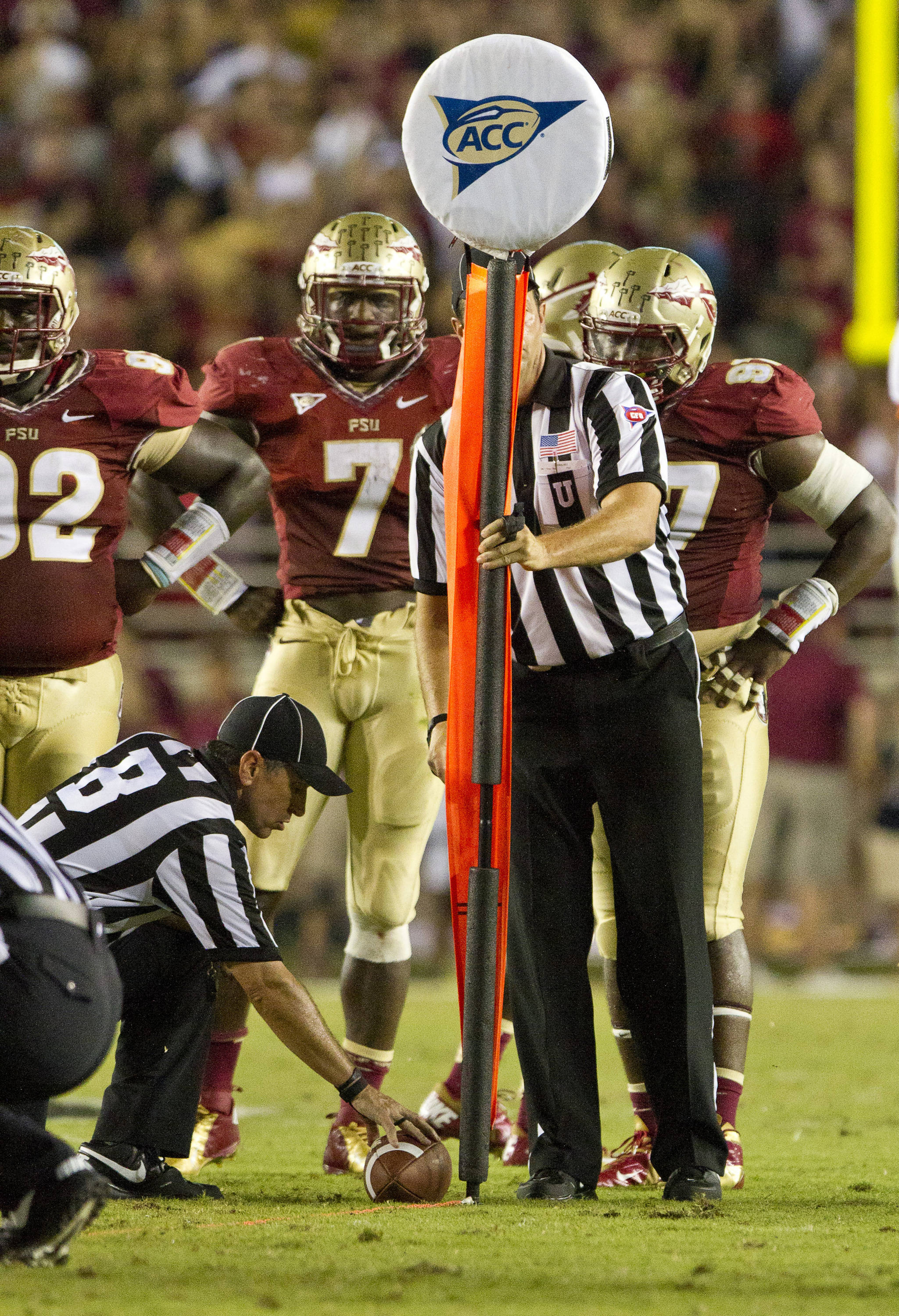 Referees check to see if a first down has been earned.