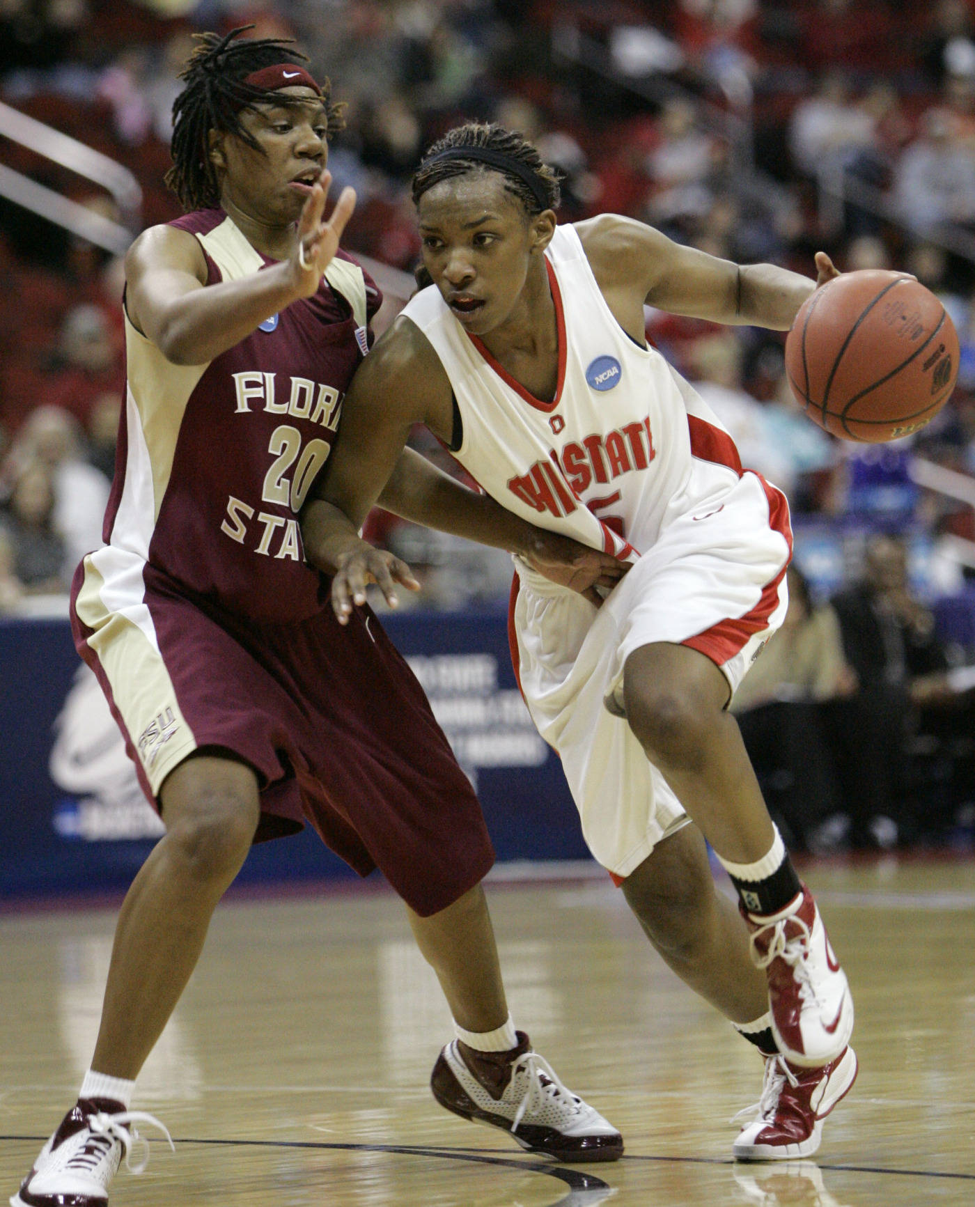 Ohio State's Tamarah Riley is fouled by Florida State's Tanae Davis-Cain during the first half. (AP Photo/Charlie Neibergall)