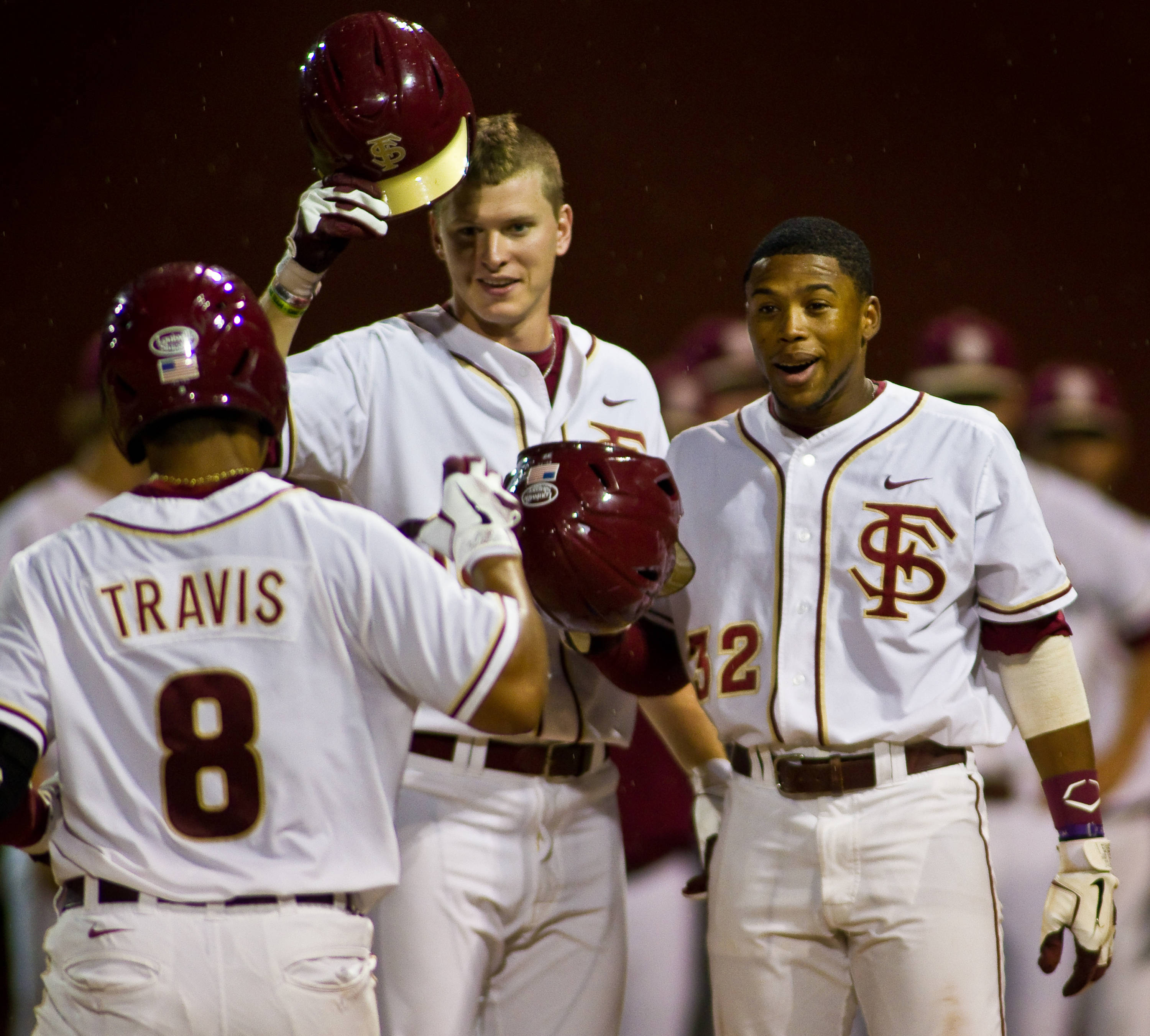 Seth Miller and Sherman Johnson greet Devon Travis at home after Travis hits his second home run of the season.