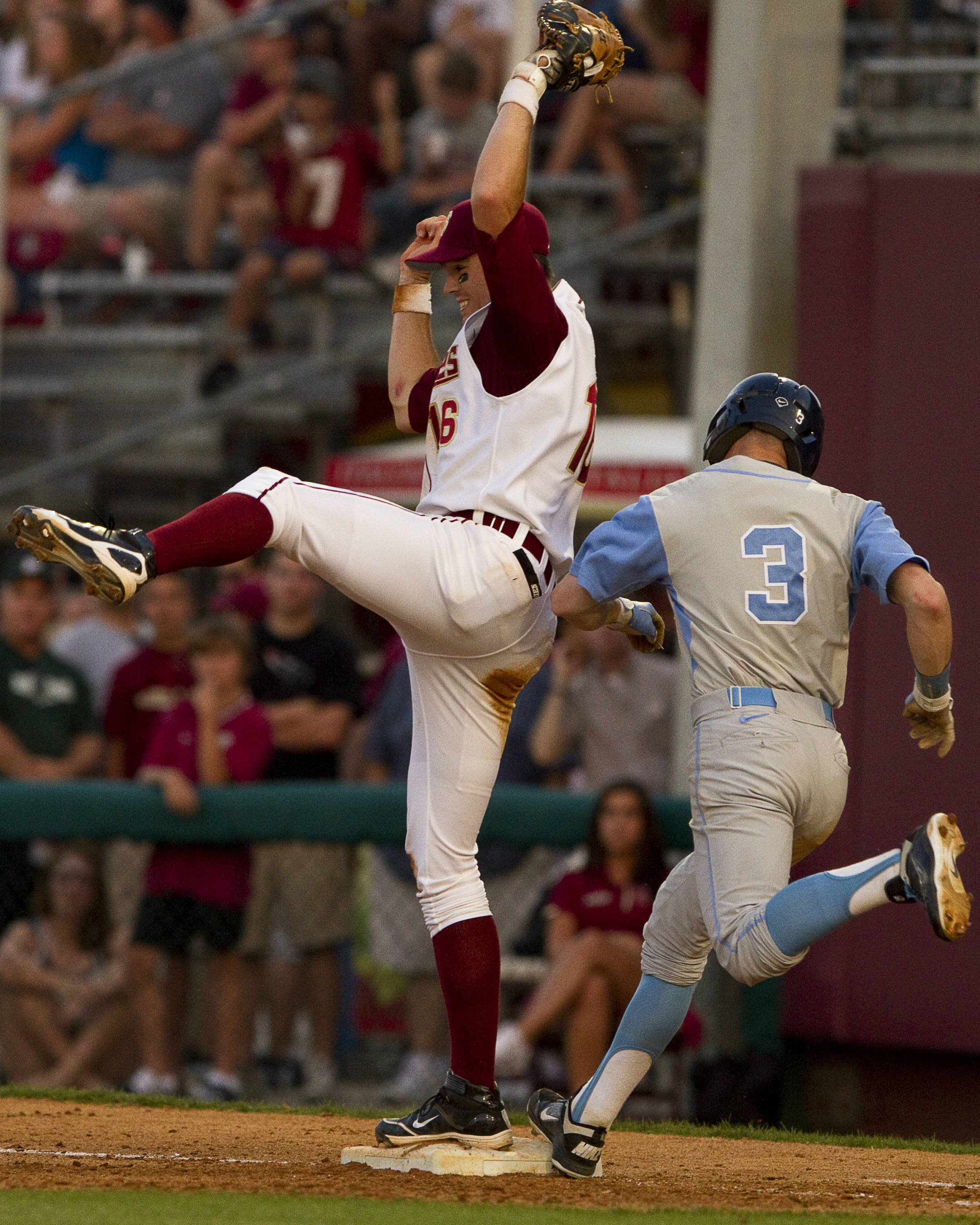 Jayce Boyd (16) makes a leaping catch to force out the runner at first.