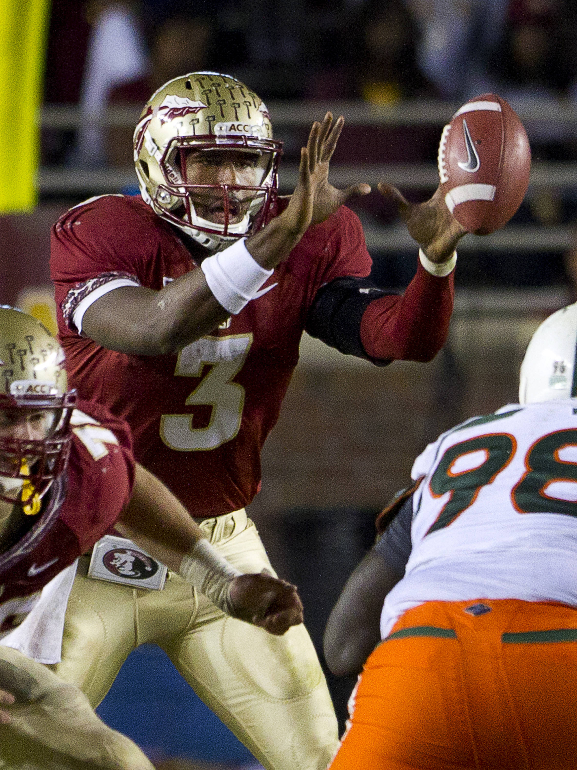 EJ Manuel (3) catches the snap during the football game against Miami on November 12, 2011.