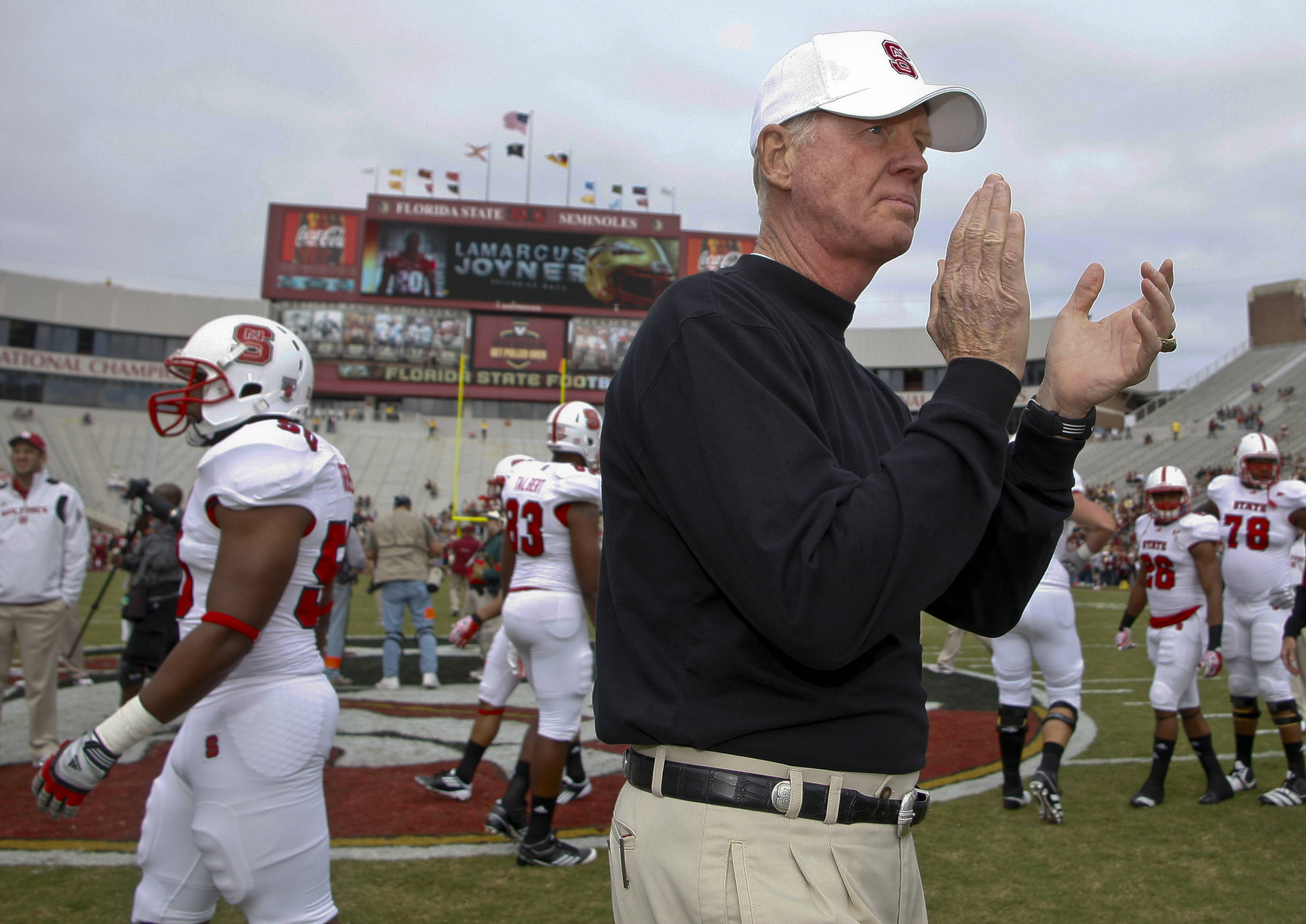 North Carolina State coach Tom O'Brien gets his team ready for an NCAA college football game against Florida State at Doak Campbell Stadium in Tallahassee, Fla., Saturday, Oct. 29, 2011. (AP Photo/Phil Sears)