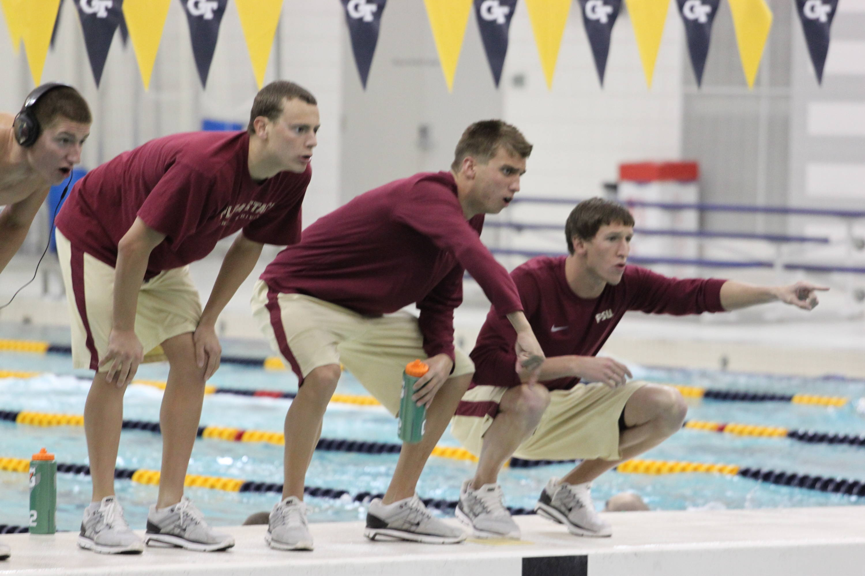 Trice Bailey, Mike Thomas, Paul Murray and Mark Weber cheer on the Seminole swimmers.