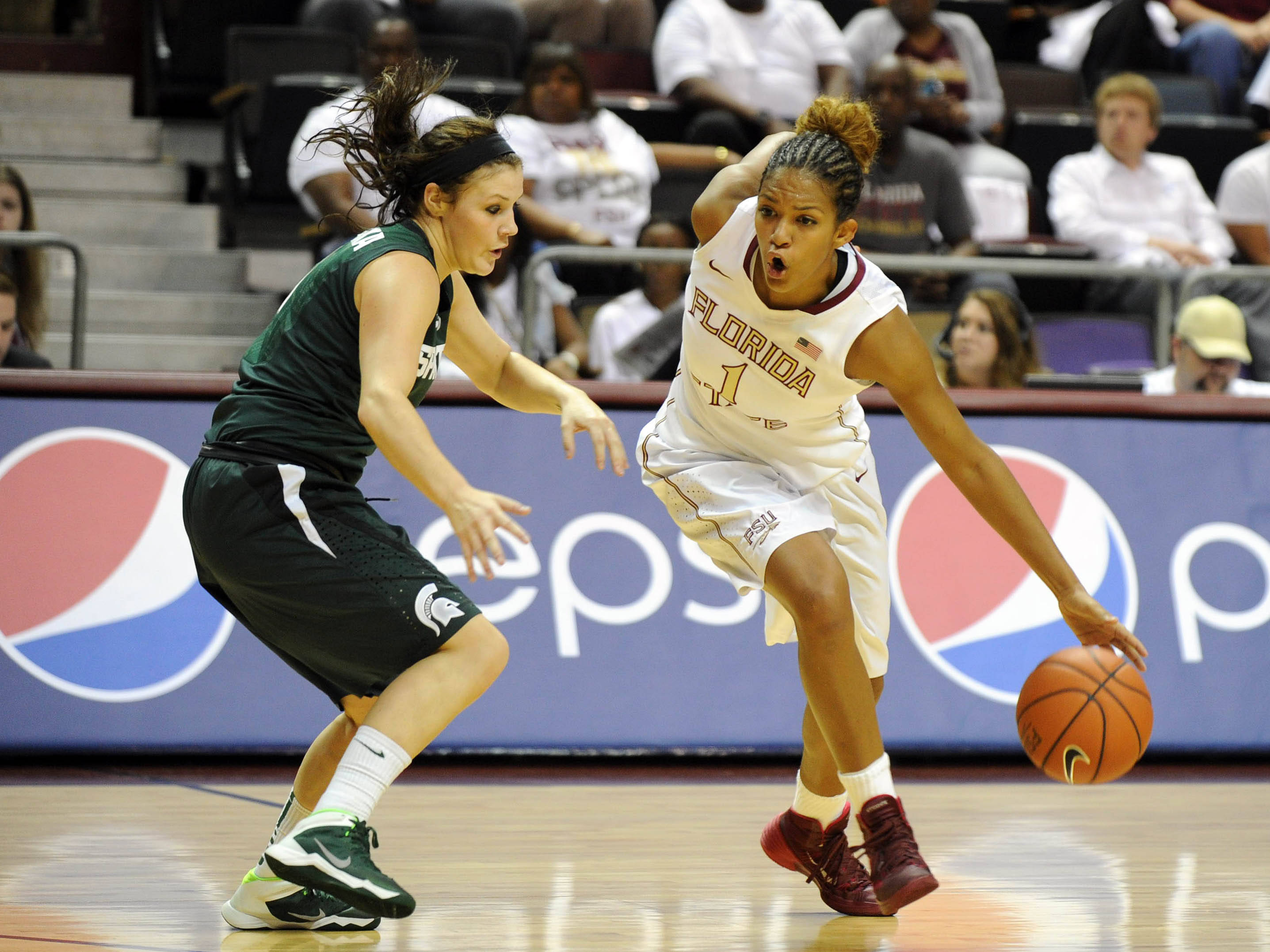 Dec 4, 2013; Tallahassee, FL, USA; Florida State Seminoles guard Morgan Jones (1) moves past Michigan State Spartans guard Tori Jankoska (1) during the game at the Donald L. Tucker Center (Tallahassee). Mandatory Credit: Melina Vastola-USA TODAY Sports