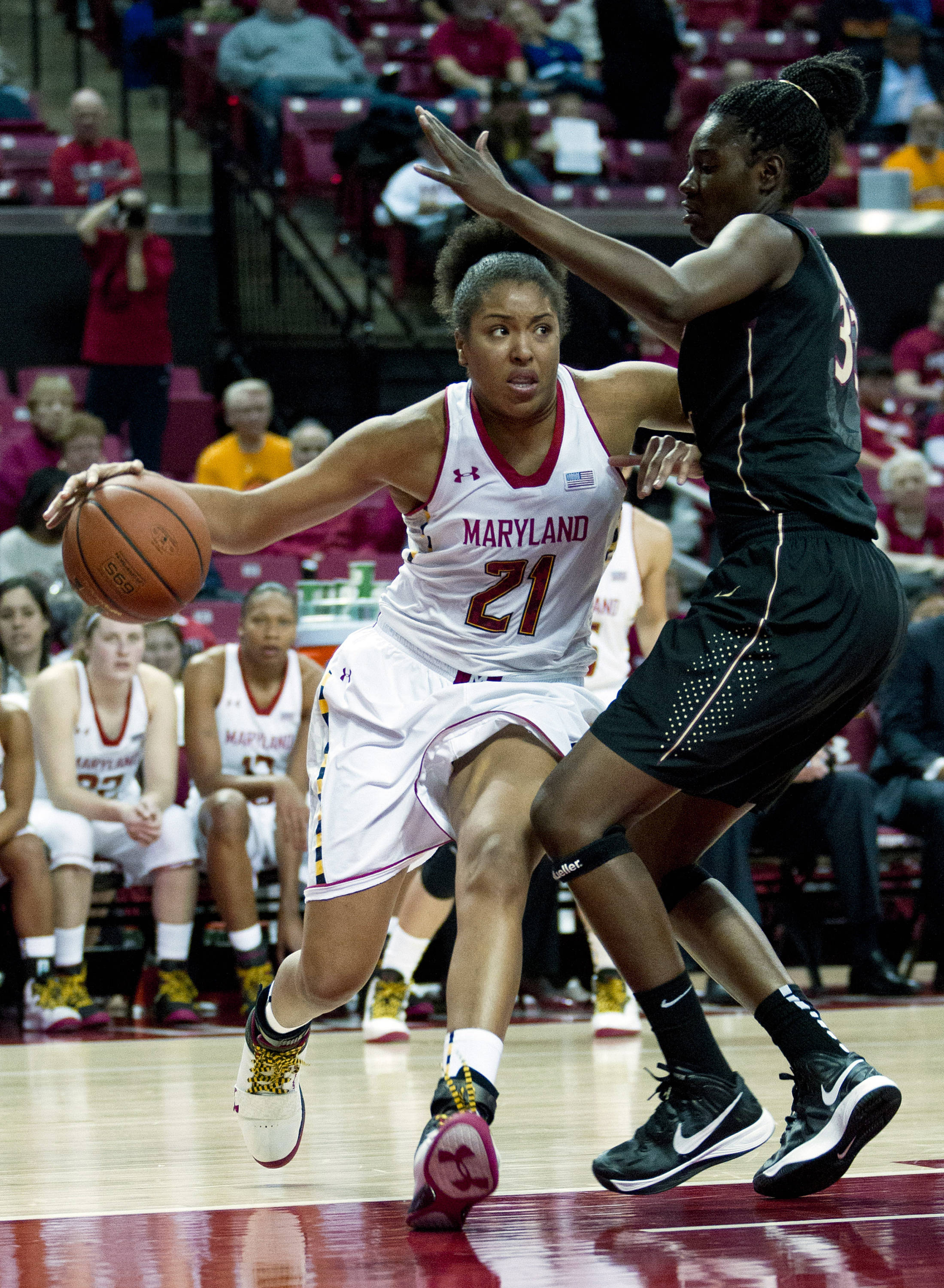 Maryland's Tianna Hawkins (21) moves the ball against Florida State's Natasha Howard during the second half. (AP Photo/Jose Luis Magana)