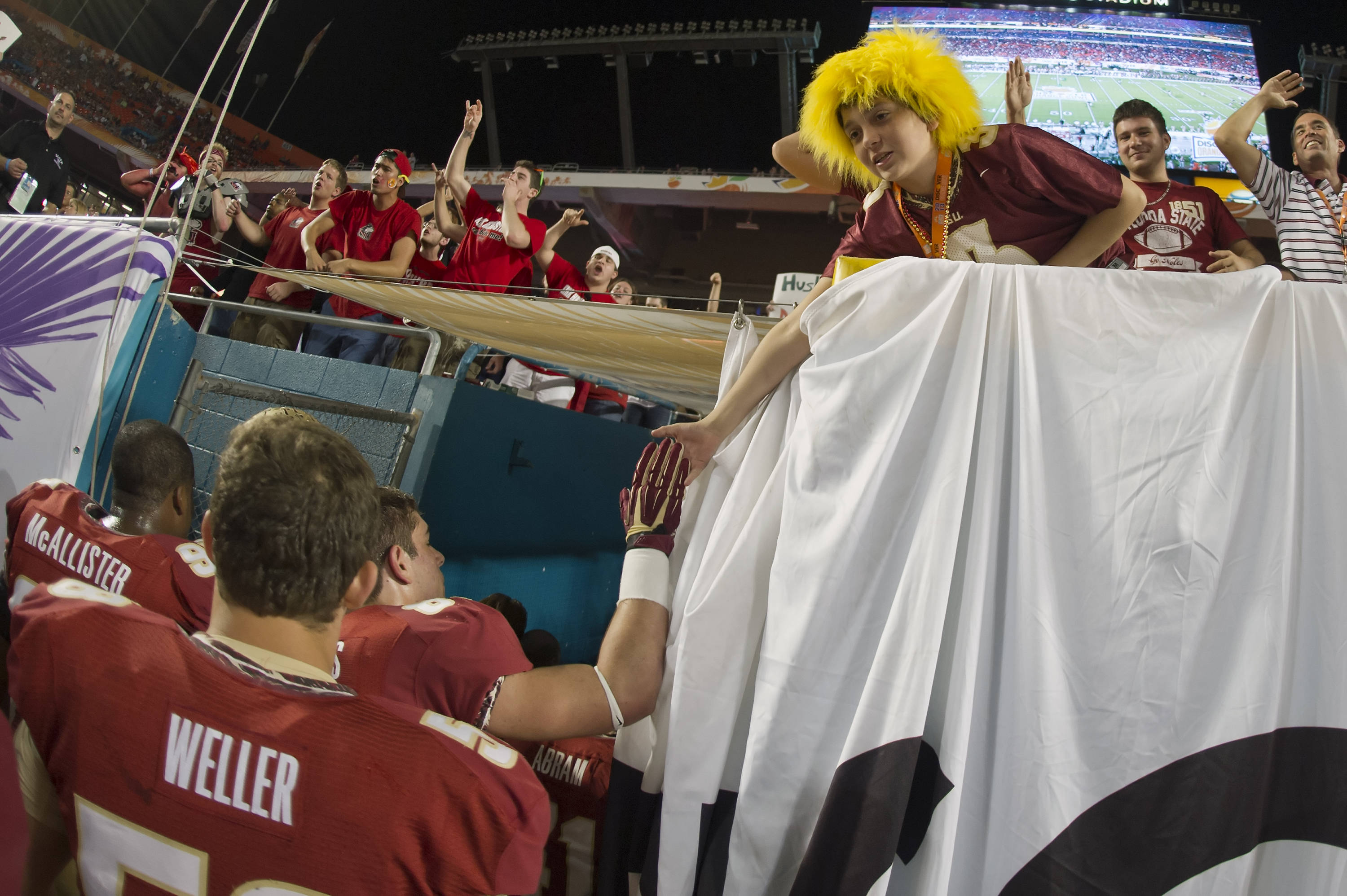 A fan gets a High-5 from an FSU player prior to kickoff