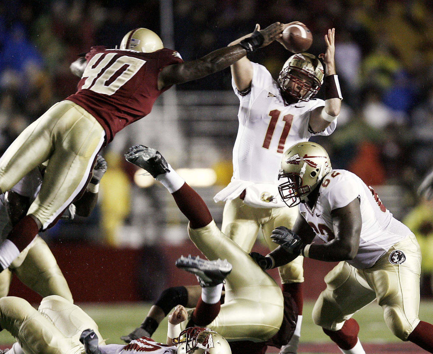 Florida State quarterback Drew Weatherford (11) tries to escape the rush of Boston College's JoLonn Dunbar (40) during the first half of a football game in Boston on Saturday, Nov. 3, 2007. (AP Photo/Winslow Townson)