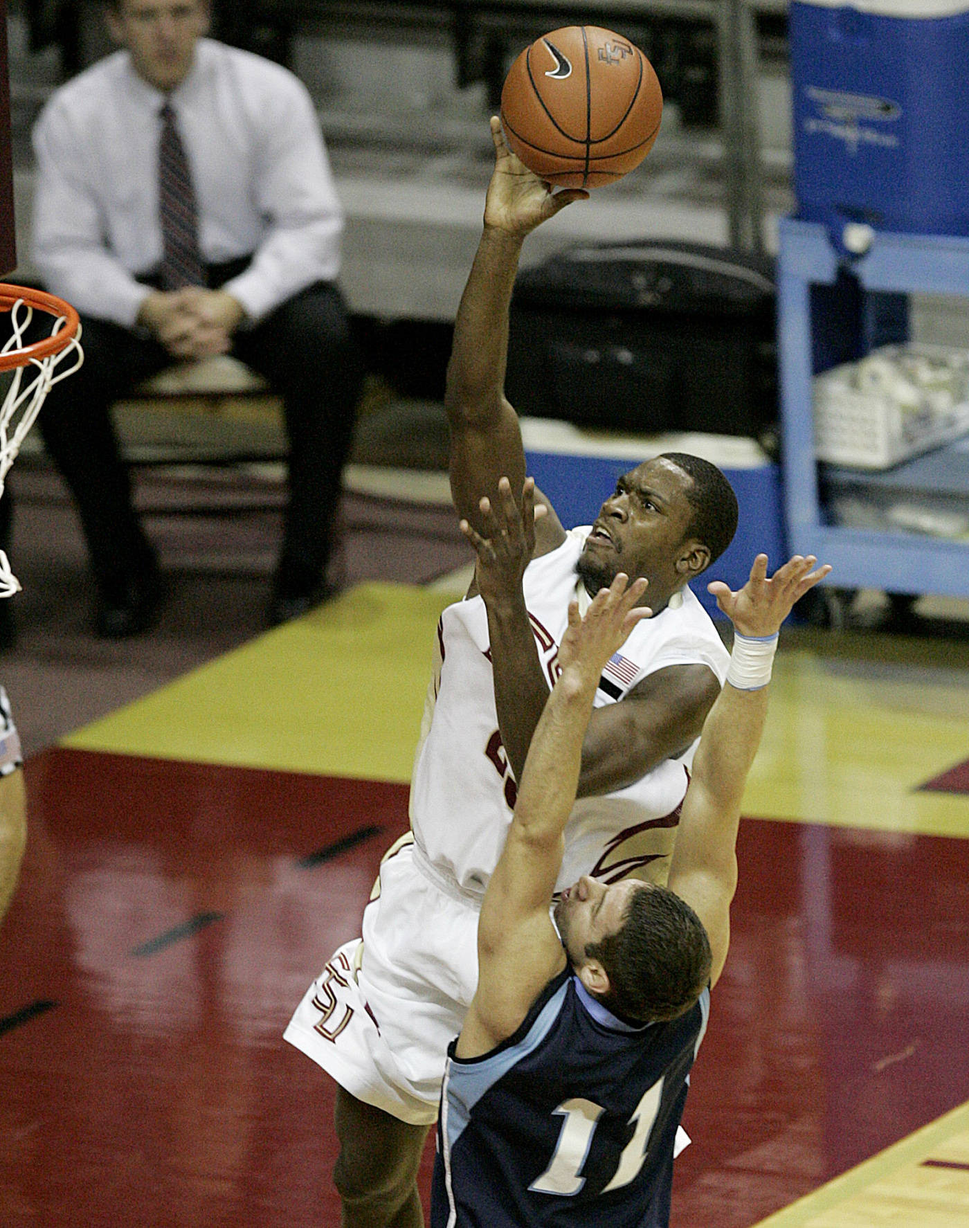Florida State's Toney Douglas soars and scores over Maine's Jason Hight in the first half.