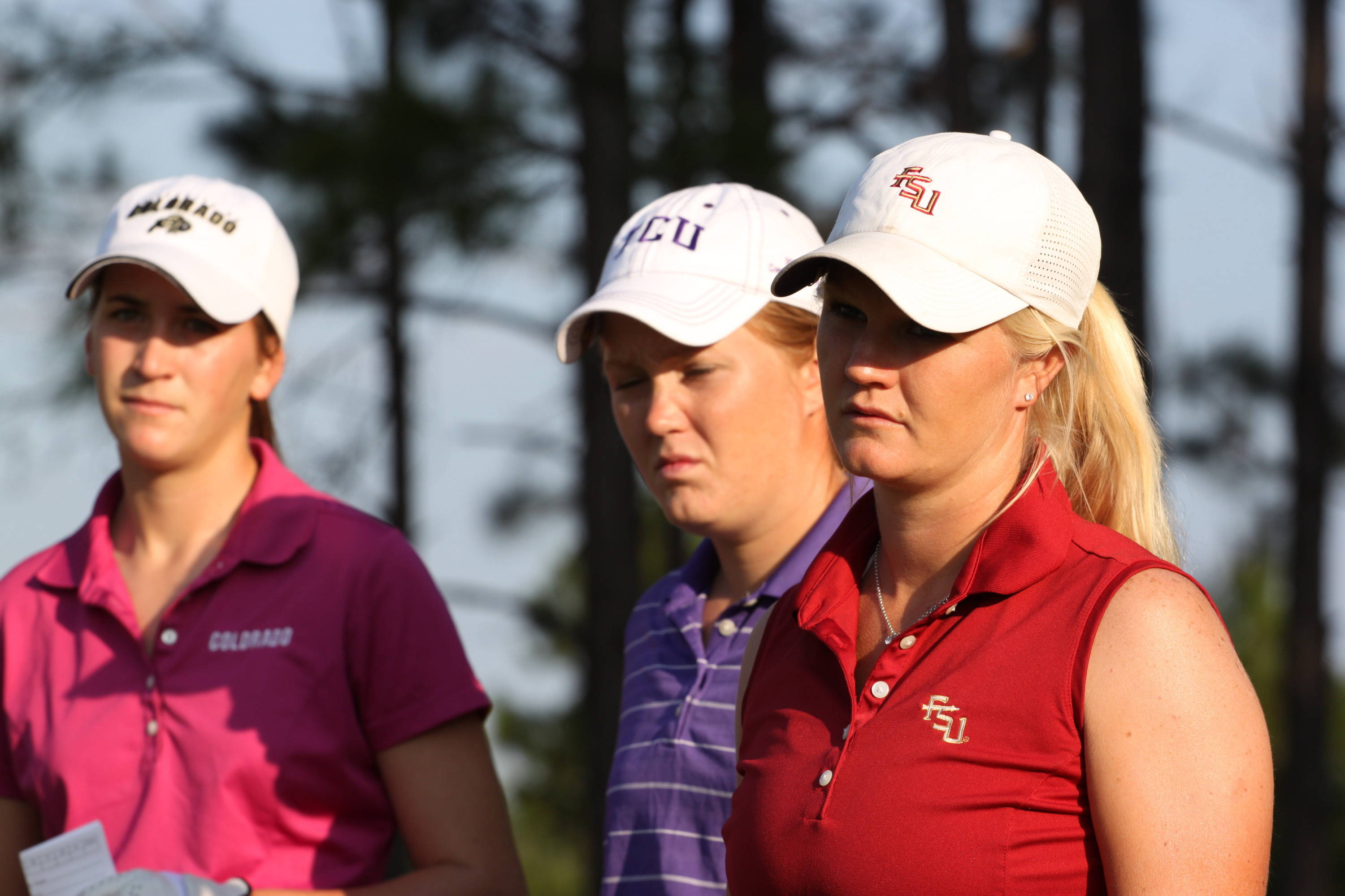 2011 NCAA Golf -- Hannah Thomson listens intently to the rules official.