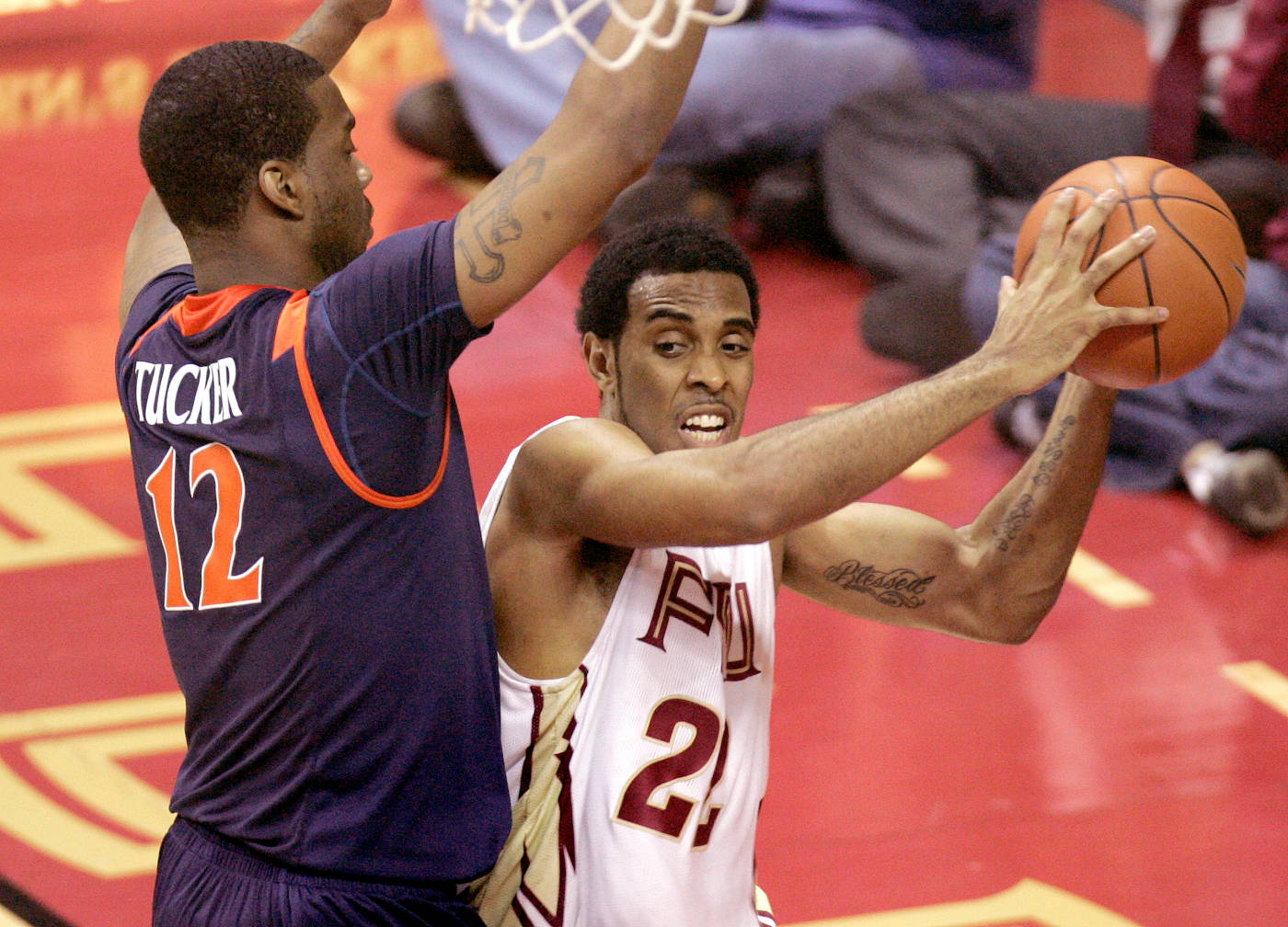 Florida State's Derwin Kitchen, right, attempts to pass around Virginia's Jamil Tucker in the first half. (AP Photo/Phil Coale)