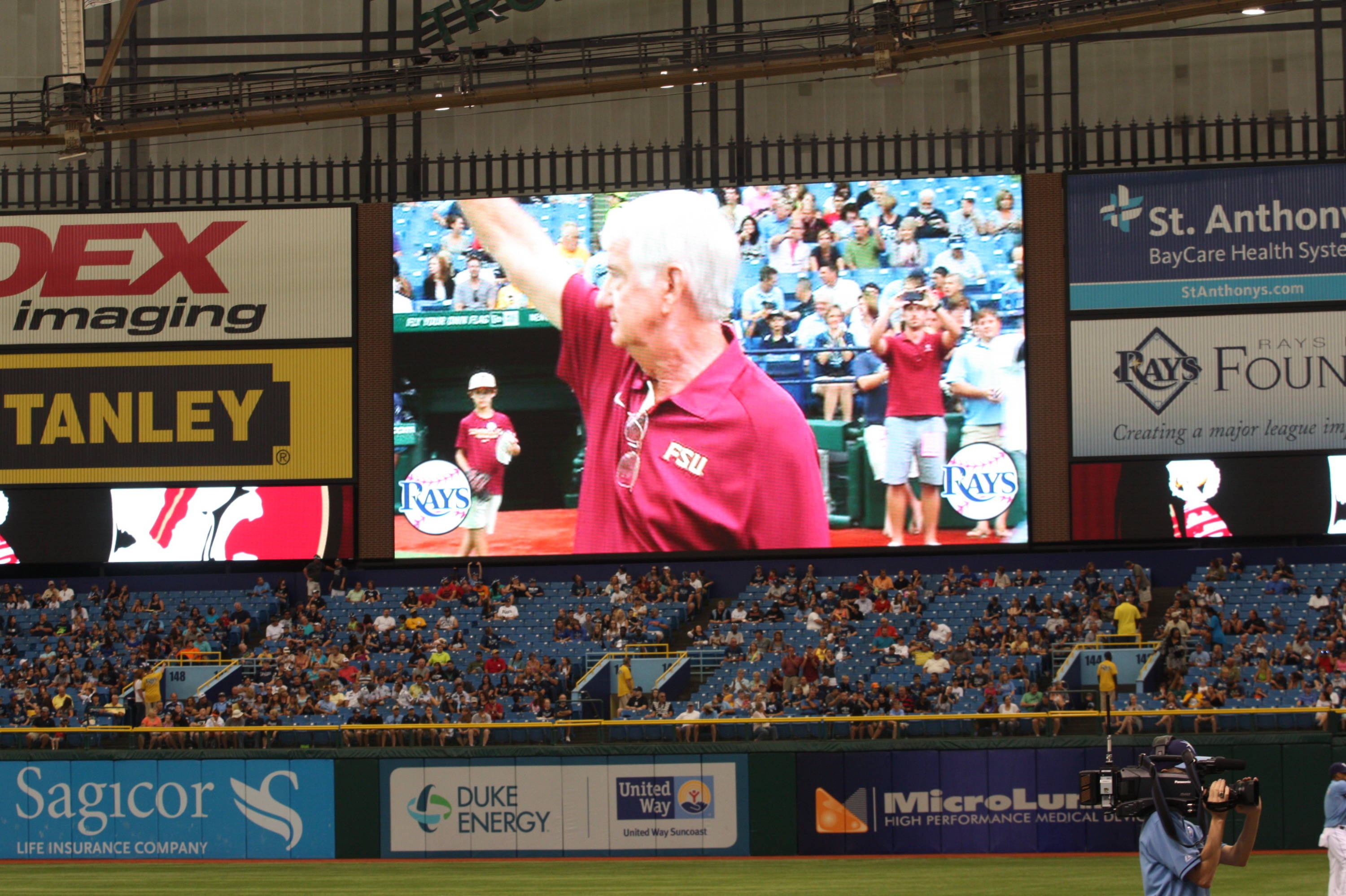 Head coach Mike Martin waves to the crowd before the first pitch.