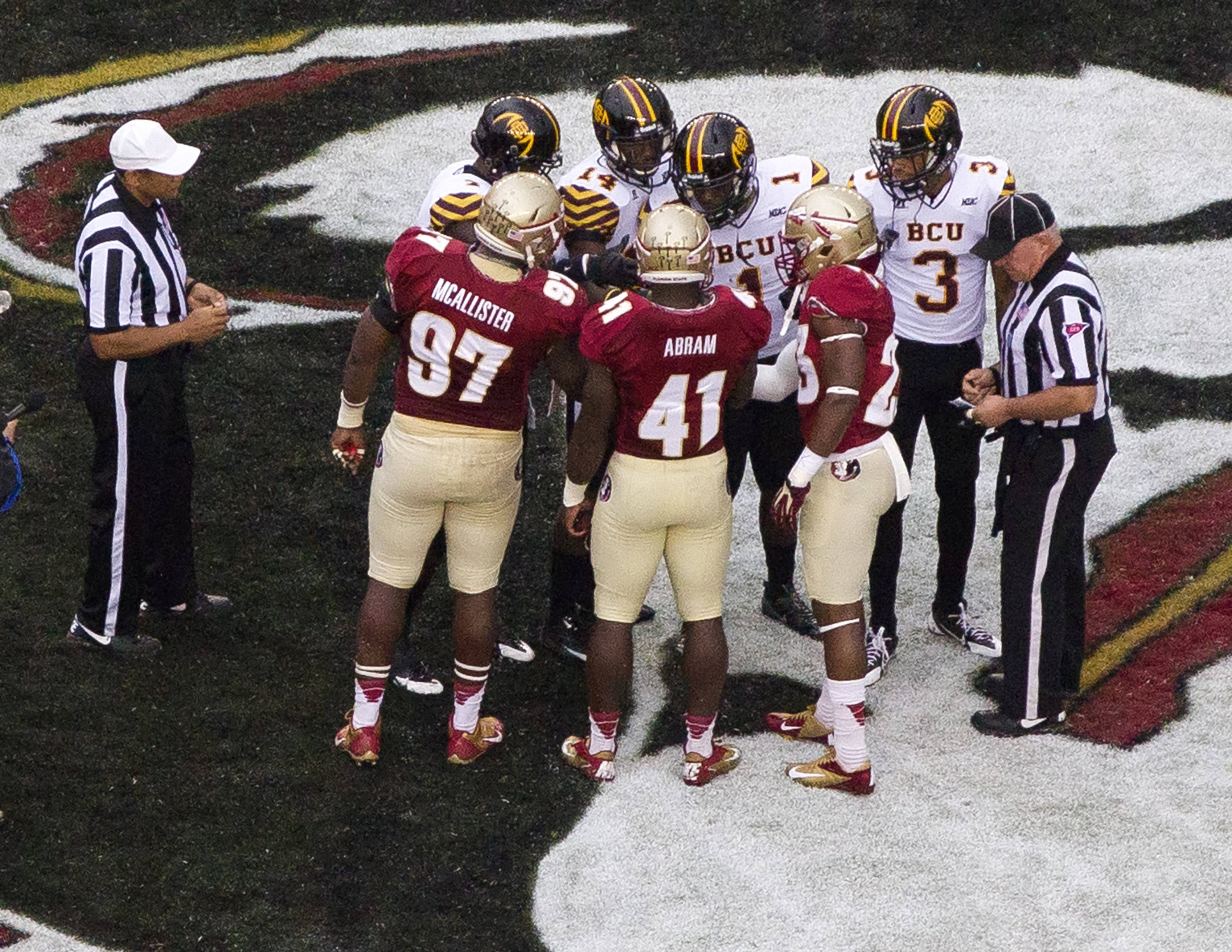Demonte McAllister (97), Chad Abram (41), Gerald Demps (23), FSU vs Bethune-Cookman,  9-21-13, (Photo by Steve Musco)
