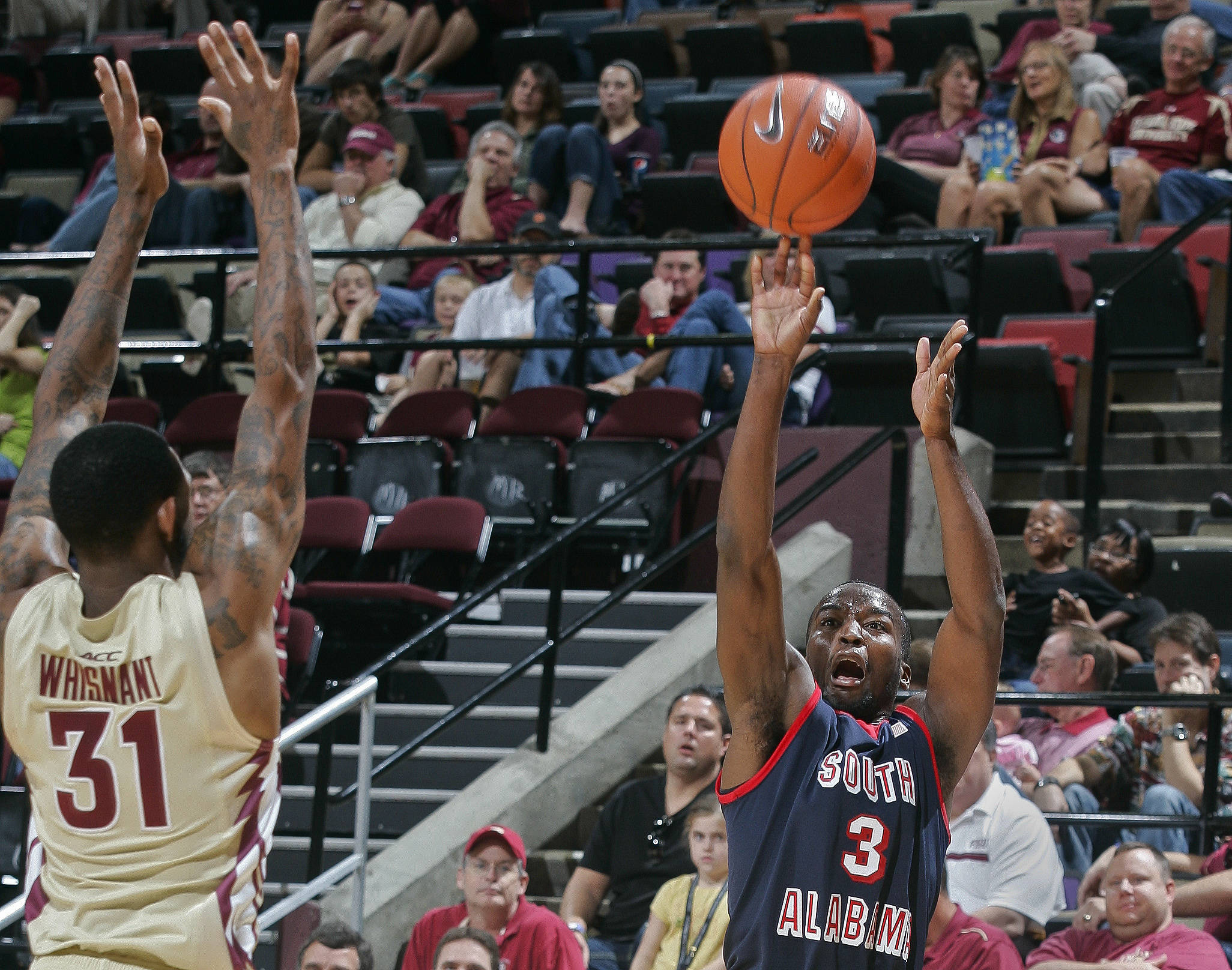 Florida State guard Terry Whisnant (31) pressures South Alabama guard Xavier Roberson (3) into missing a three-point shot. (AP Photo/Phil Sears)