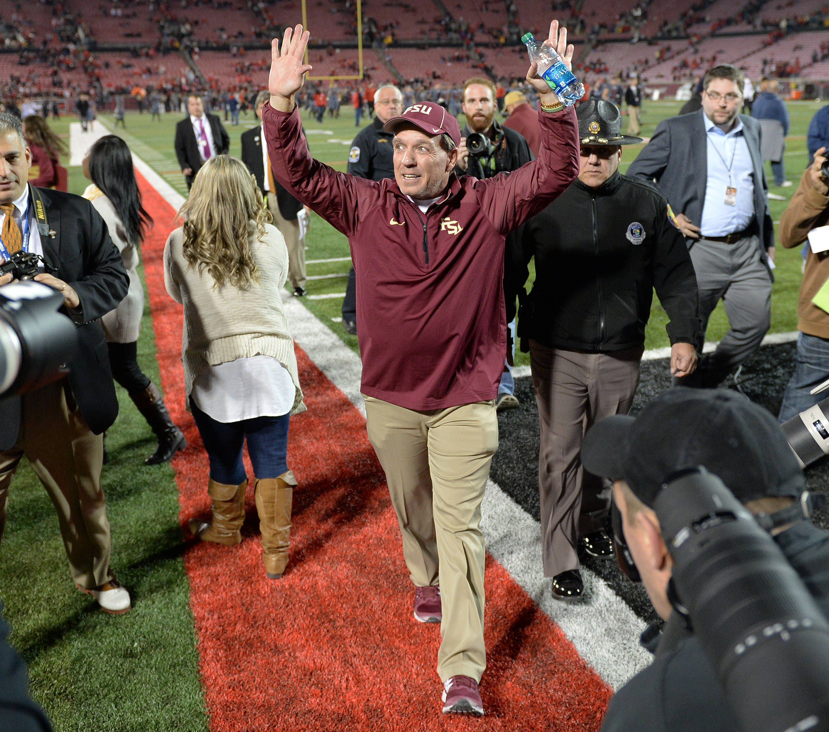 Jimbo Fisher celebrates as he walks off the field