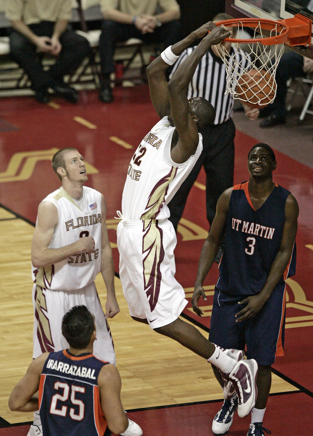 Florida State's Solomon Alabi scores with a reverse dunk as teammate Jordan DeMercy and Tennessee-Martin's Andres Irarrazabal, left, and Dominique Mpondo watch in the second half of an NCAA college basketball game which Florida State won 95-68 on Tuesday, Dec. 22, 2009, in Tallahassee, Fla. (AP Photo/Steve Cannon)