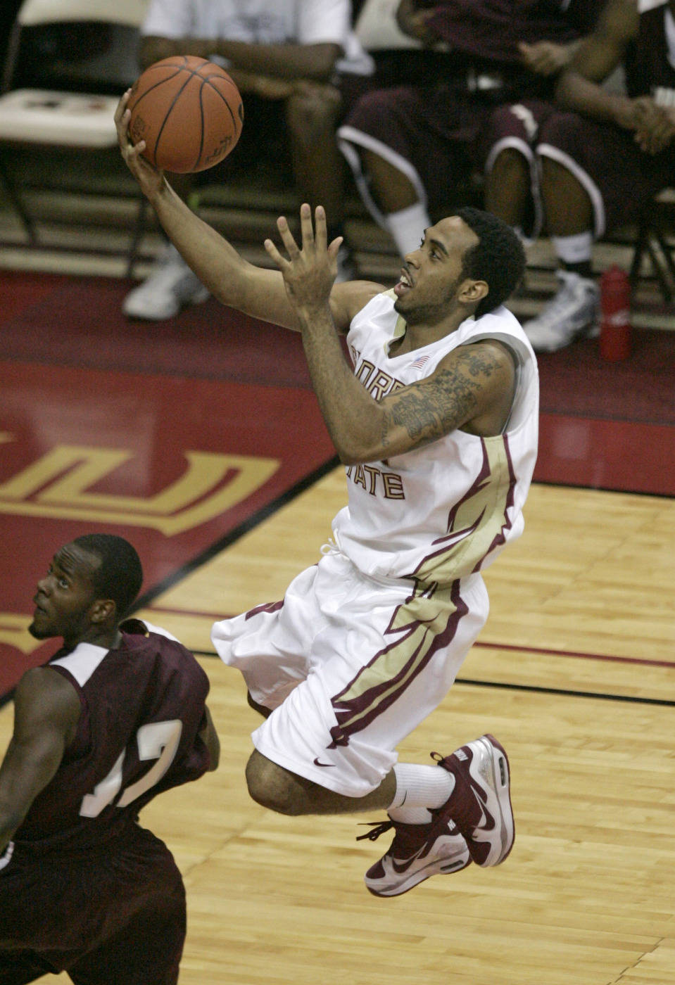 Florida State's Derwin Kitchen scores on a breakaway past the defense of Alabama A&M's Jabari DeSheilds in the first half of an NCAA college basketball game Thursday, Dec. 31, 2009, in Tallahassee, Fla. (AP Photo/Steve Cannon)
