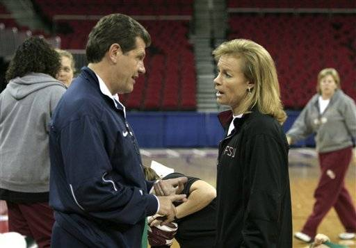Connecticut coach Geno Auriemma, left, talks with Florida State coach Sue Semrau between their teams' practice sessions in Fresno, Calif., Friday, March 23, 2007, the day before an NCAA women's basketball tournament regional semifinal between their teams. (AP Photo/Rich Pedroncelli)