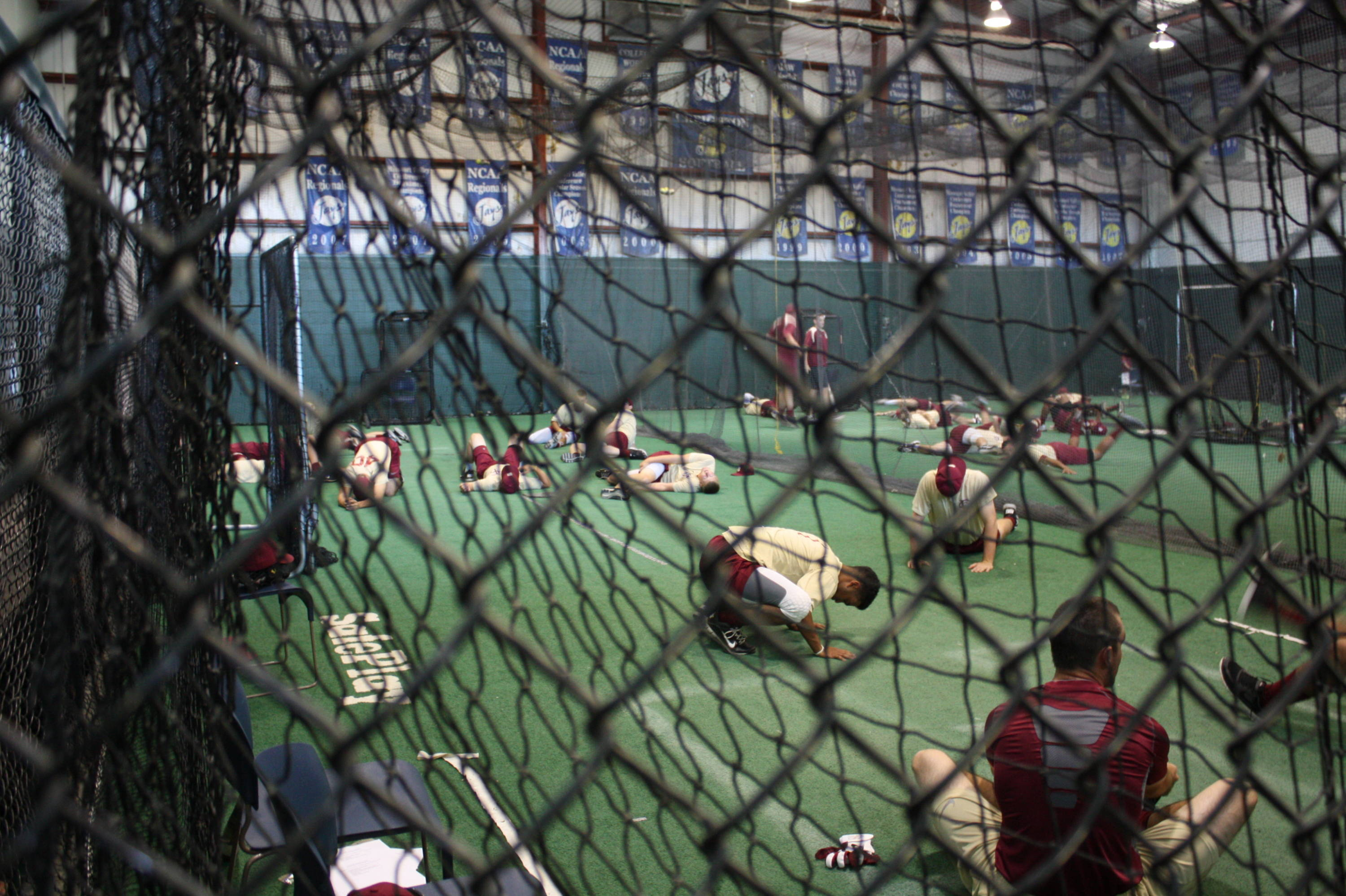 The Seminoles stretching before the start of practice inside the Creighton indoor hitting facility.