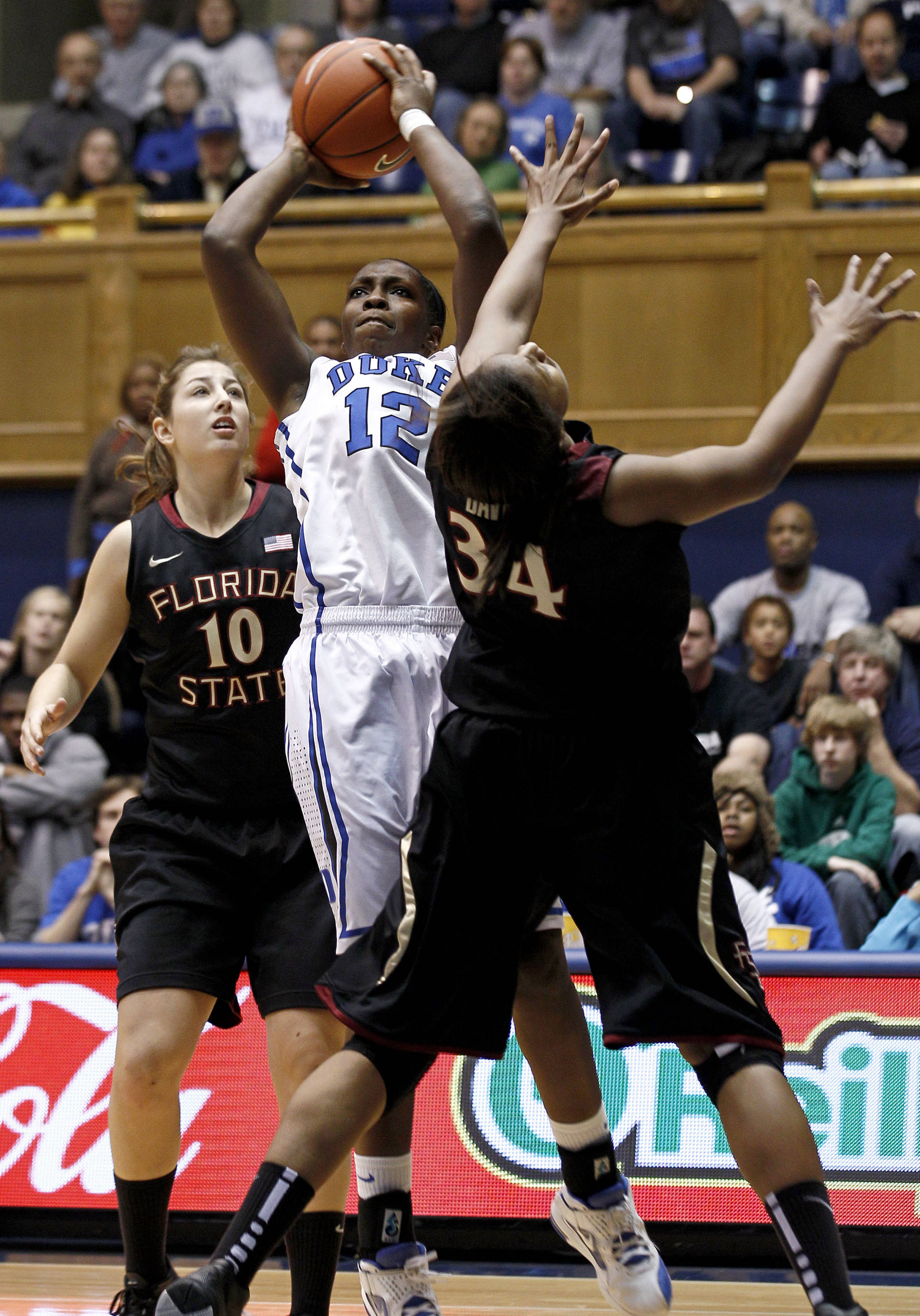 Duke's Chelsea Gray (12) shoots as Florida State's Leonor Rodriguez (10) and Chelsea Davis (34) defend during the first half. (AP Photo/Gerry Broome)