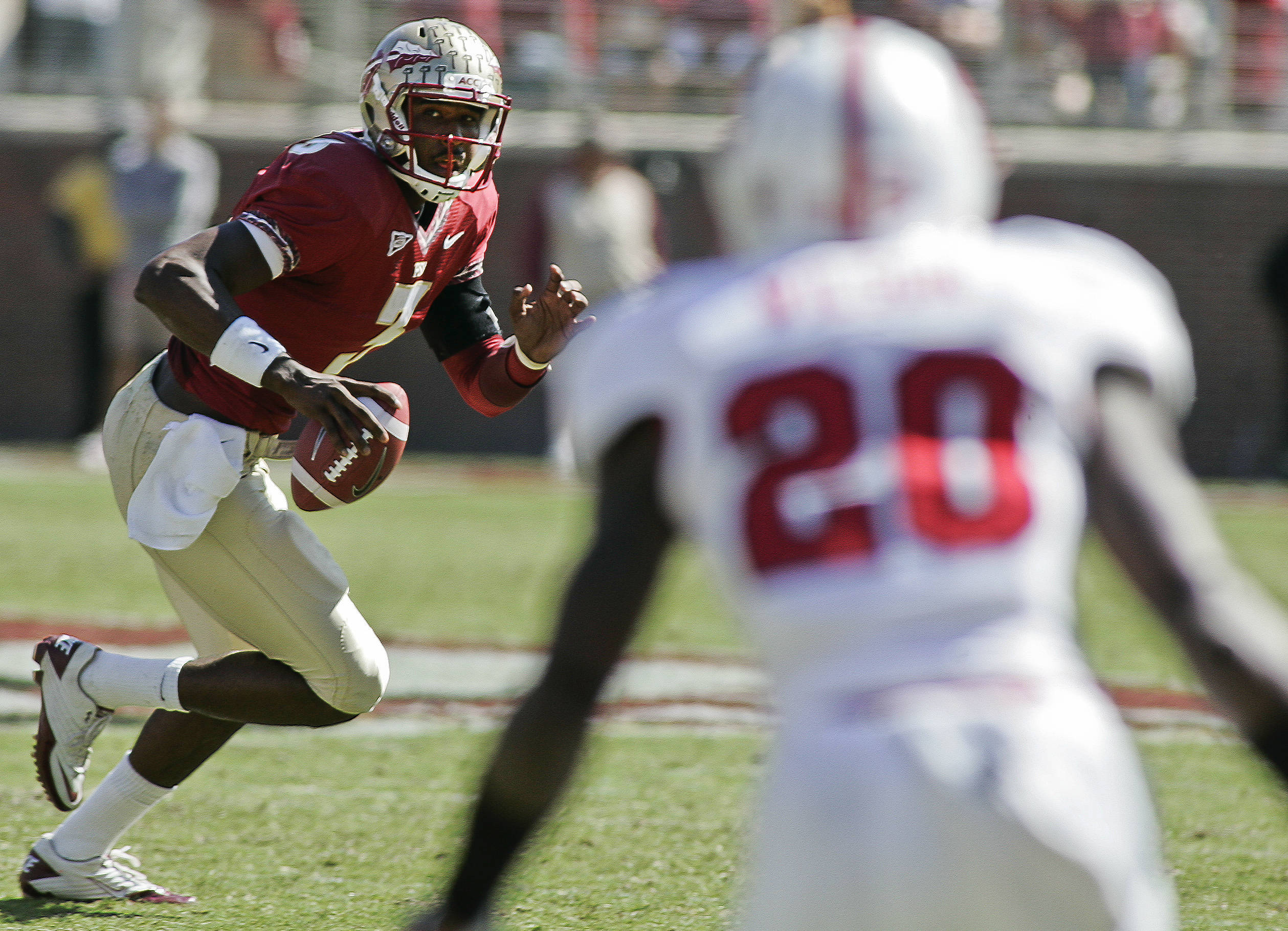 Florida State quarterback E.J. Manuel (3) scrambles out of the pocket in the second quarter against North Carolina State. (AP Photo/Phil Sears)
