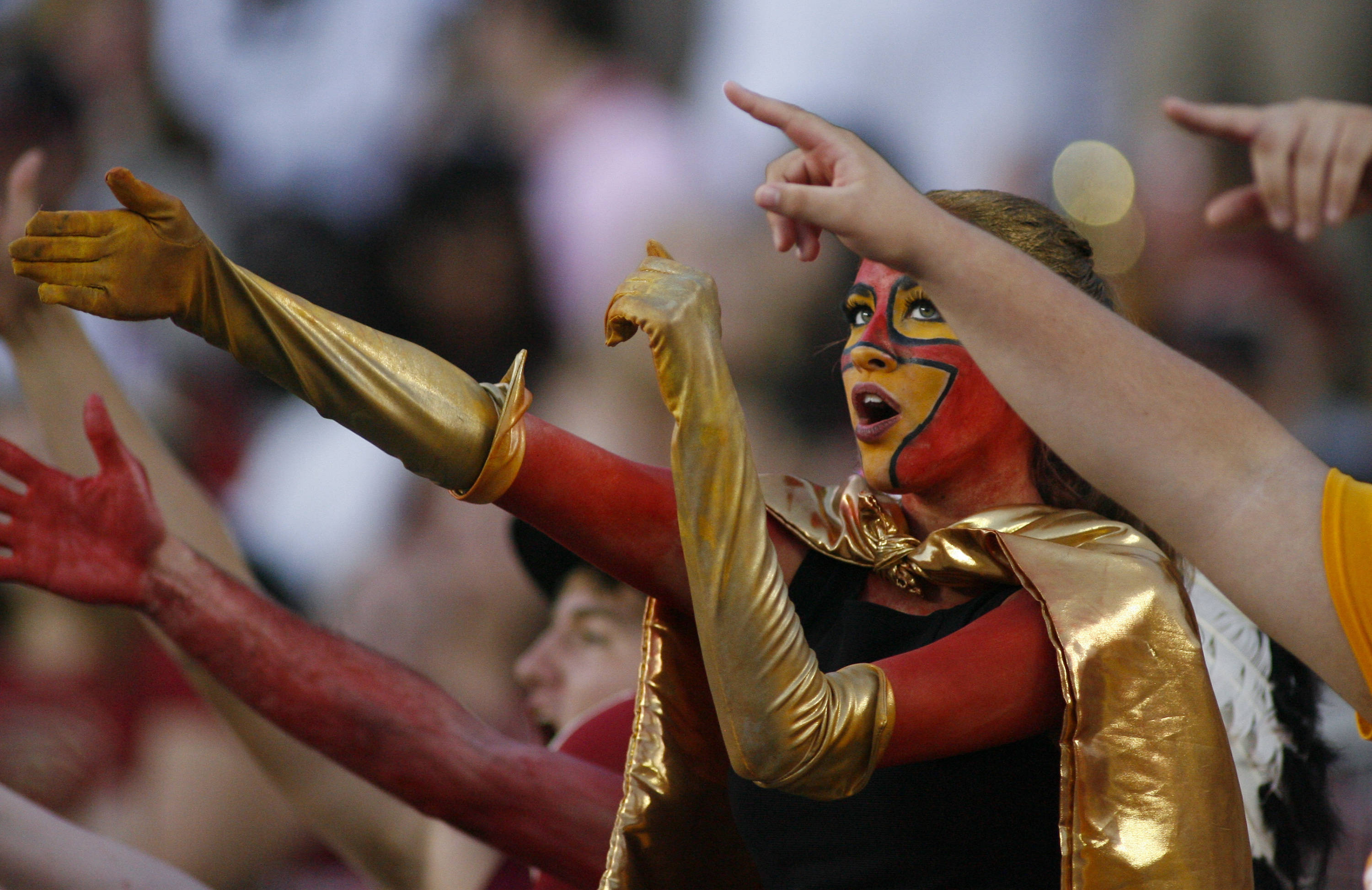 A Florida State fan does The Chop during the second quarter of the game. (AP Photo/Phil Sears)