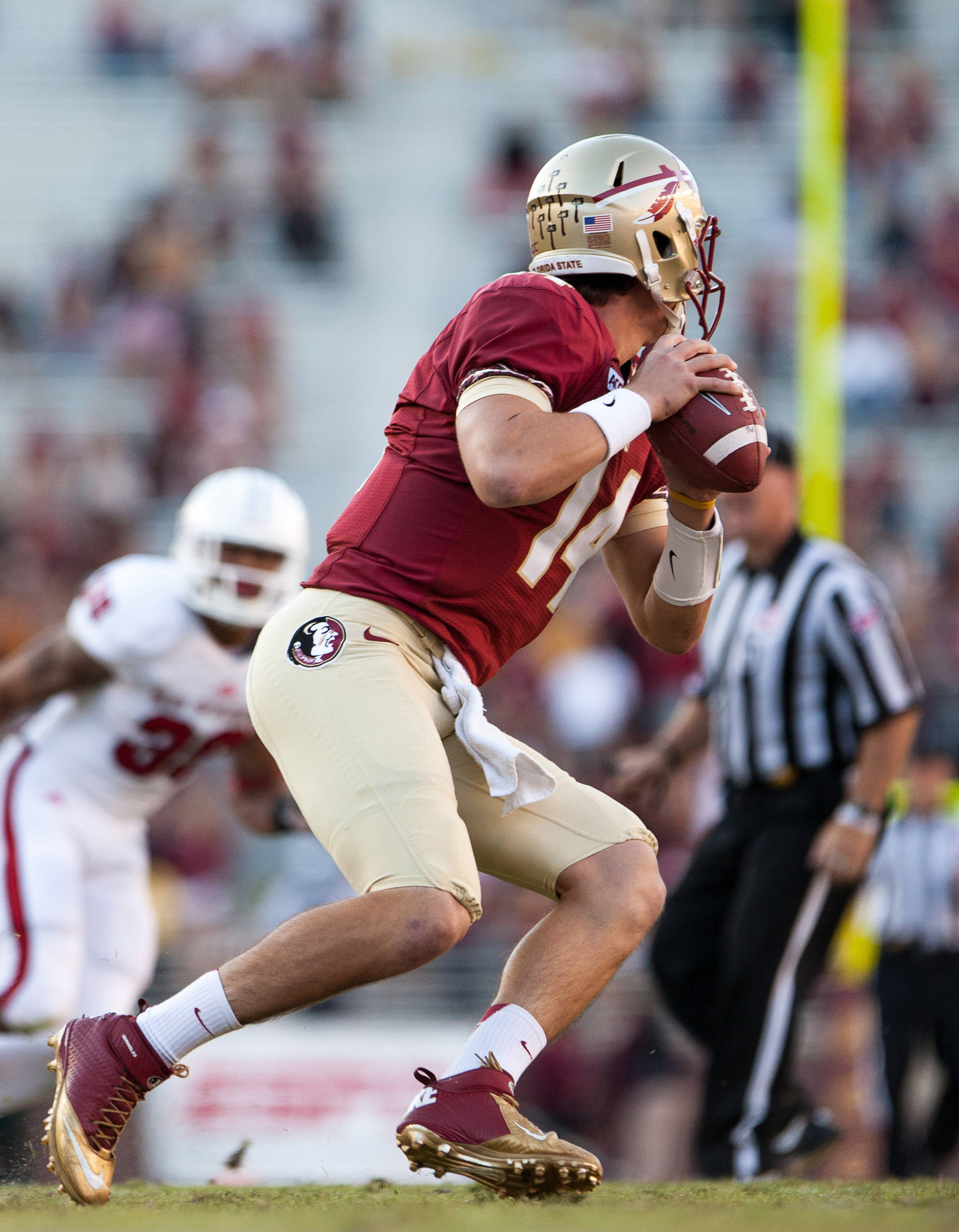 Jacob Coker (14) drops back to pass during FSU Football's 49-17 win over NC State on Saturday, October 26, 2013 in Tallahassee, Fla. Photo by Michael Schwarz.