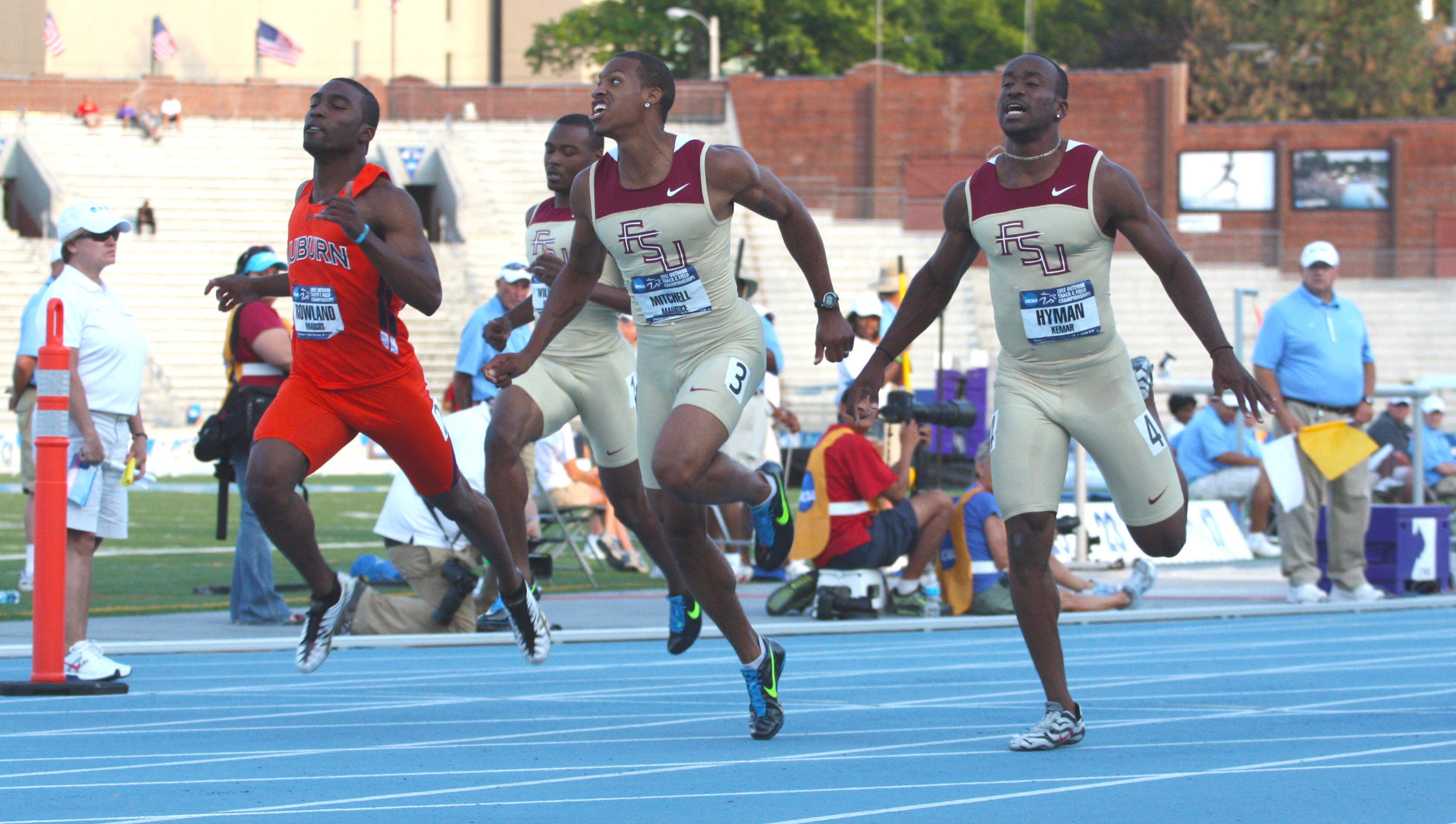 Maurice Mitchell and Kemar Hyman finish 1-2 in their 100-meter semifinal heat in 10.03 and 10.04, respectively.