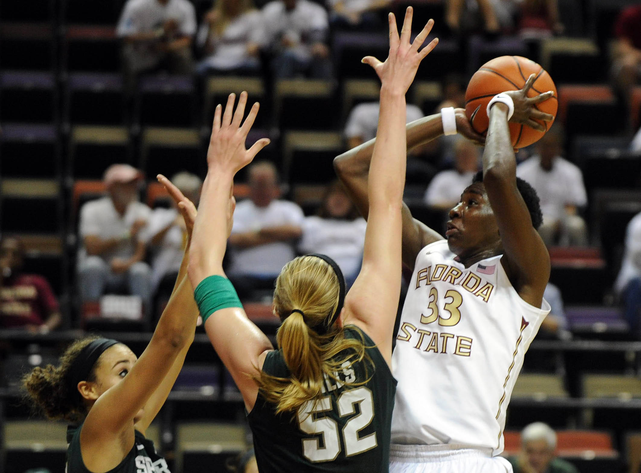 Dec 4, 2013; Tallahassee, FL, USA; Florida State Seminoles forward Natasha Howard (33) shoots over Michigan State Spartans forward Becca Mills (52)  during the game at the Donald L. Tucker Center (Tallahassee). Mandatory Credit: Melina Vastola-USA TODAY Sports