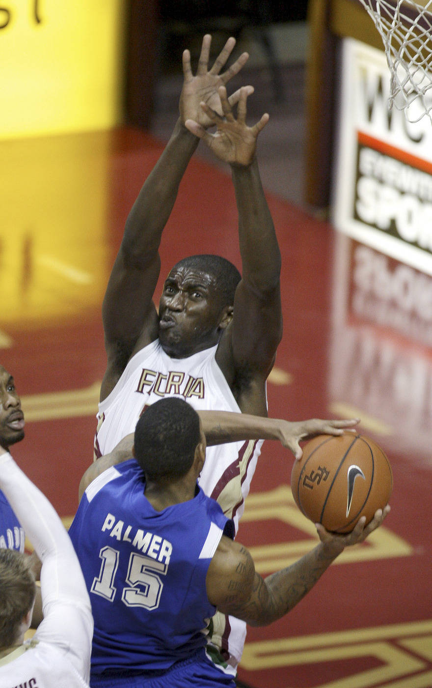 Texas A&M-Corpus Christi's Kevin Palmer tries to shoot around the defensive efforts of Florida State's Solomon Alabi during the second half of an NCAA college basketball game Monday, Jan. 4, 2010, in Tallahassee, Fla. (AP Photo/Phil Coale)