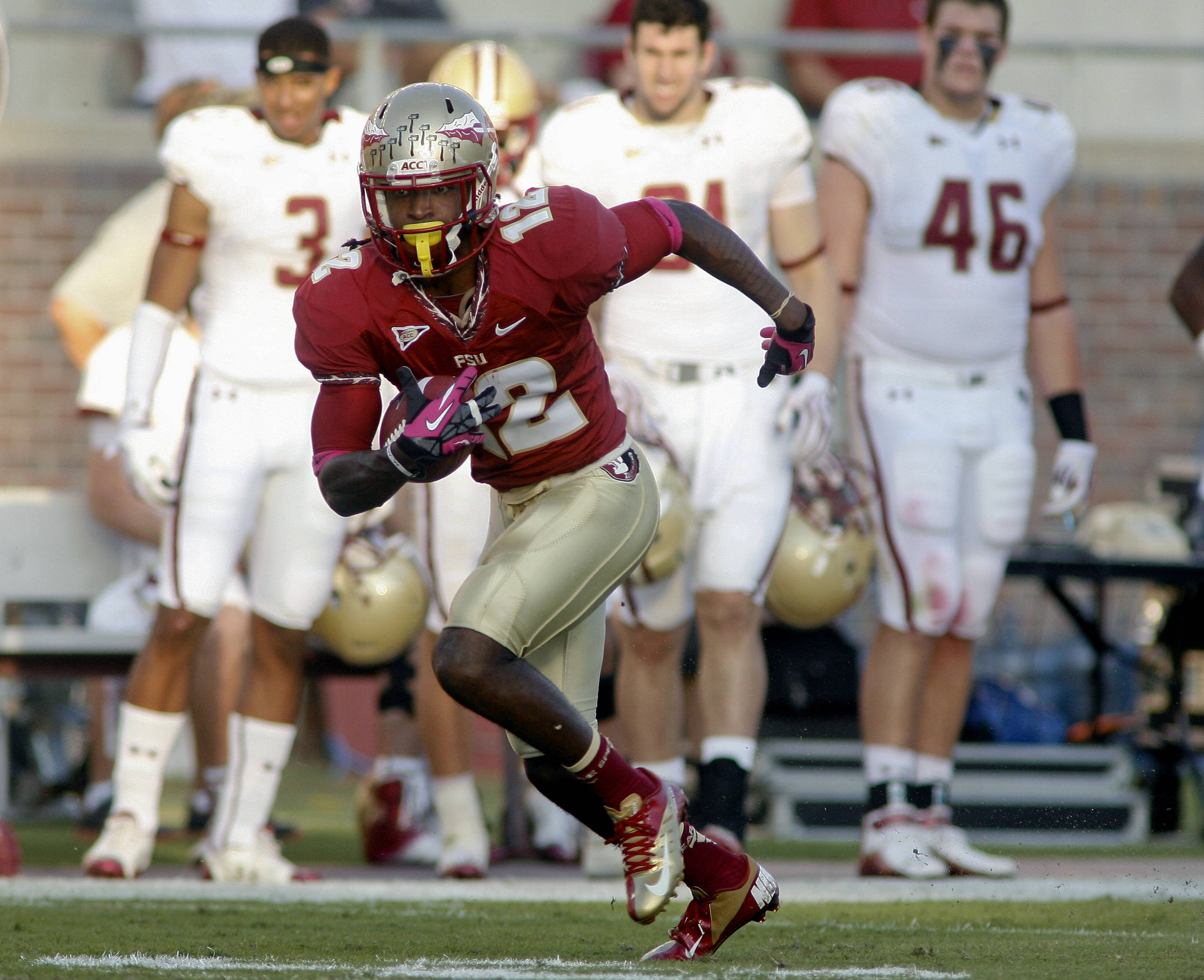 Florida State wide receiver Jarred Haggins (12) runs for a 42-yard gain after catching a pass in the first quarter. (AP Photo/Phil Sears)