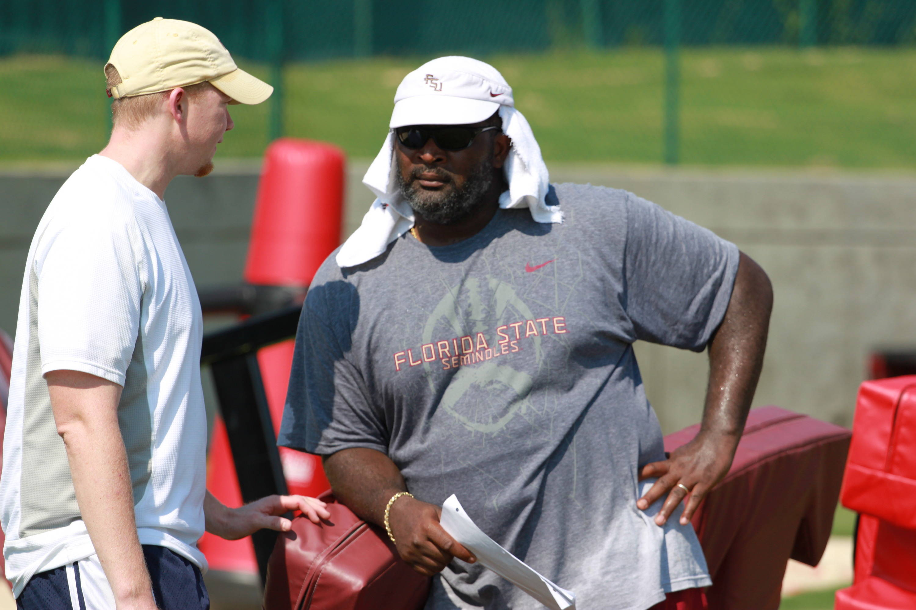 Defensive tackles coach Odell Haggins in his familiar warm weather headgear.