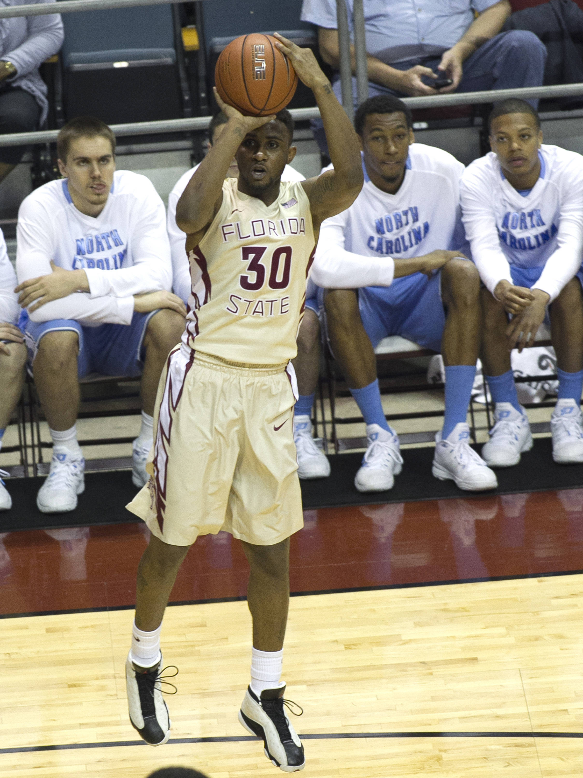 Ian Miller(30) with a jumper in front of the North Carolina bench, FSU vs North Carolina, 2-17-14, (Photo's by Steve Musco)