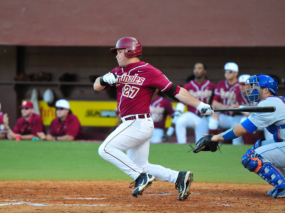 Stuart Tapley drives home the game's first run with this hard-hit grounder which escaped UF shorstop Nolan Fontana.