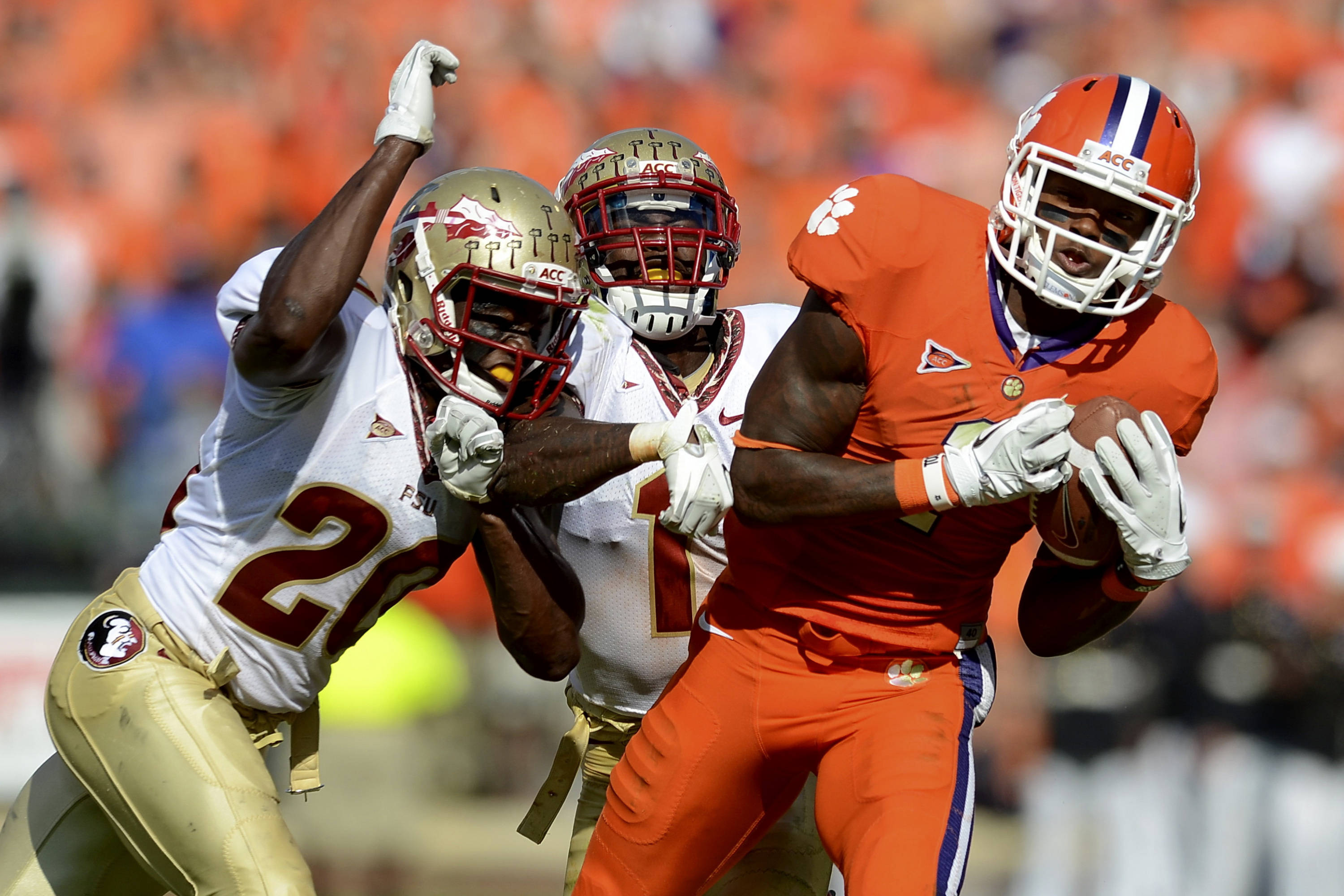 Clemson wide receiver Martavis Bryant makes a 33 yard reception over Florida State defenders, Lamarcus Joyner (20) and Mike Harris (1) during an NCAA college football game Saturday, Sept. 24, 2011, at Memorial Stadium in Clemson, S.C.  (AP Photo/ Richard Shiro)