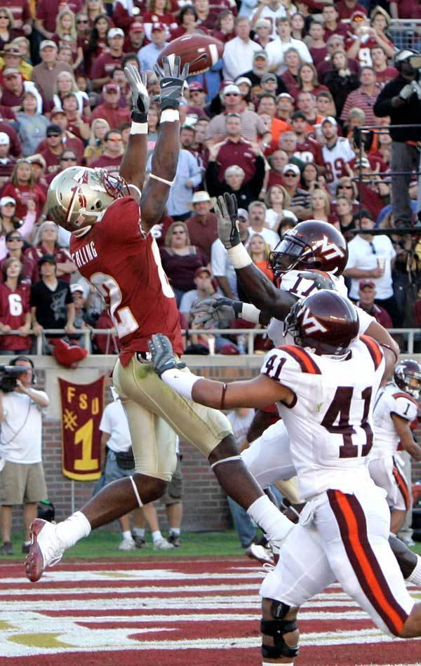 Florida State receiver Taiwan Easterling, left, makes a third-quarter touchdown catch despite the defensive efforts of Virginia Tech safety Kam Chancellor, upper right, and linebacker Cam Martin (41)