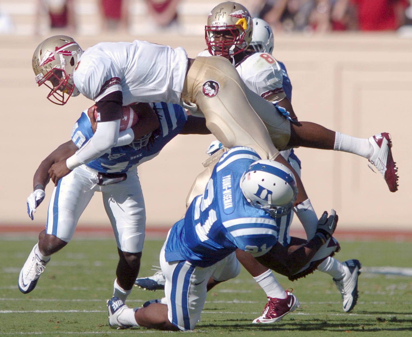 Florida State quarterback E.J. Manuel jumps over Duke's Anthony Young-Wiseman (21) for a first down. (AP Photo/The Herald-Sun, Bernard Thomas)