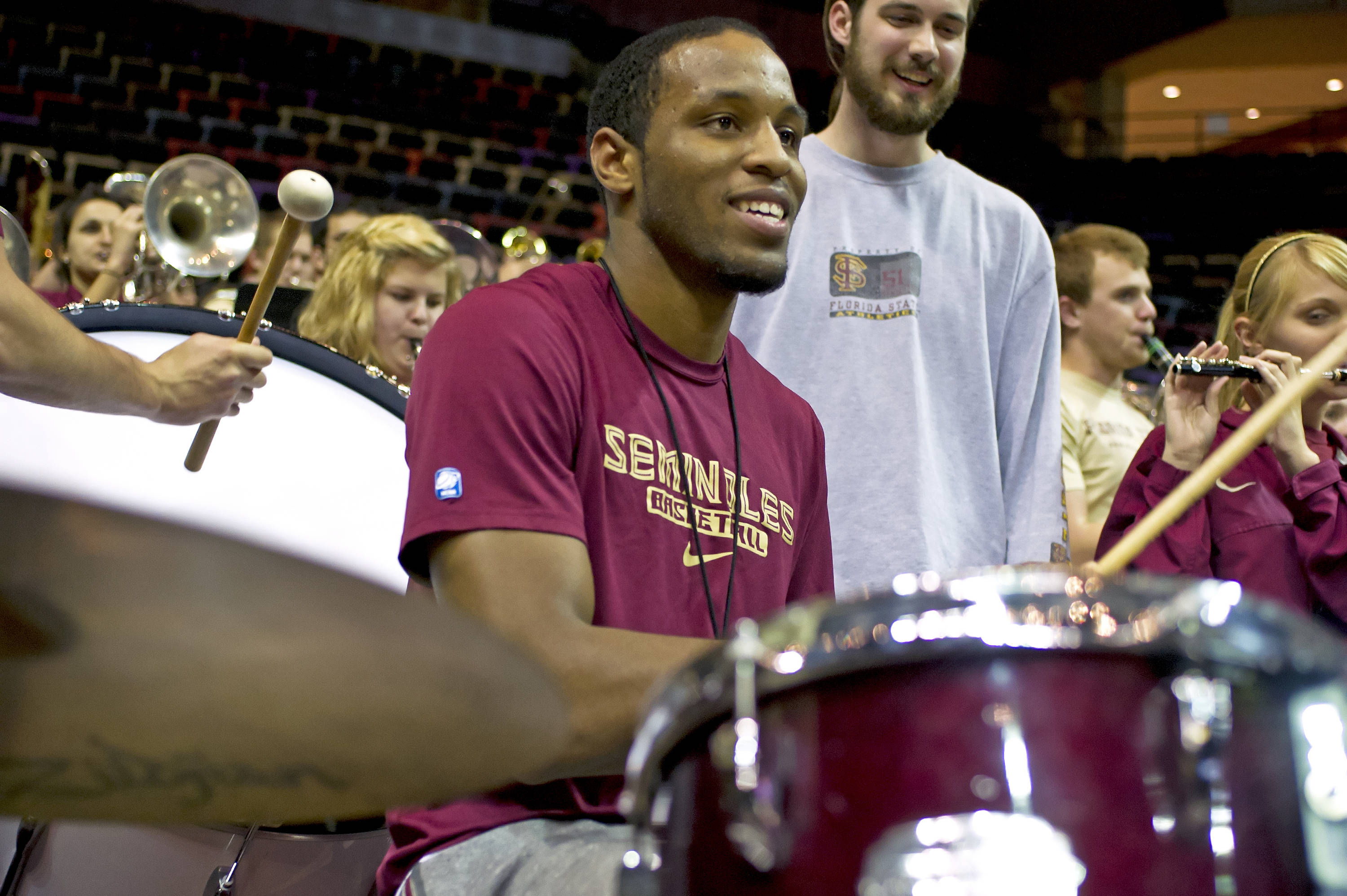 FSU Men's basketball player Michael Snaer serenades the Women's Basketball Team on the drums at the end of the game.