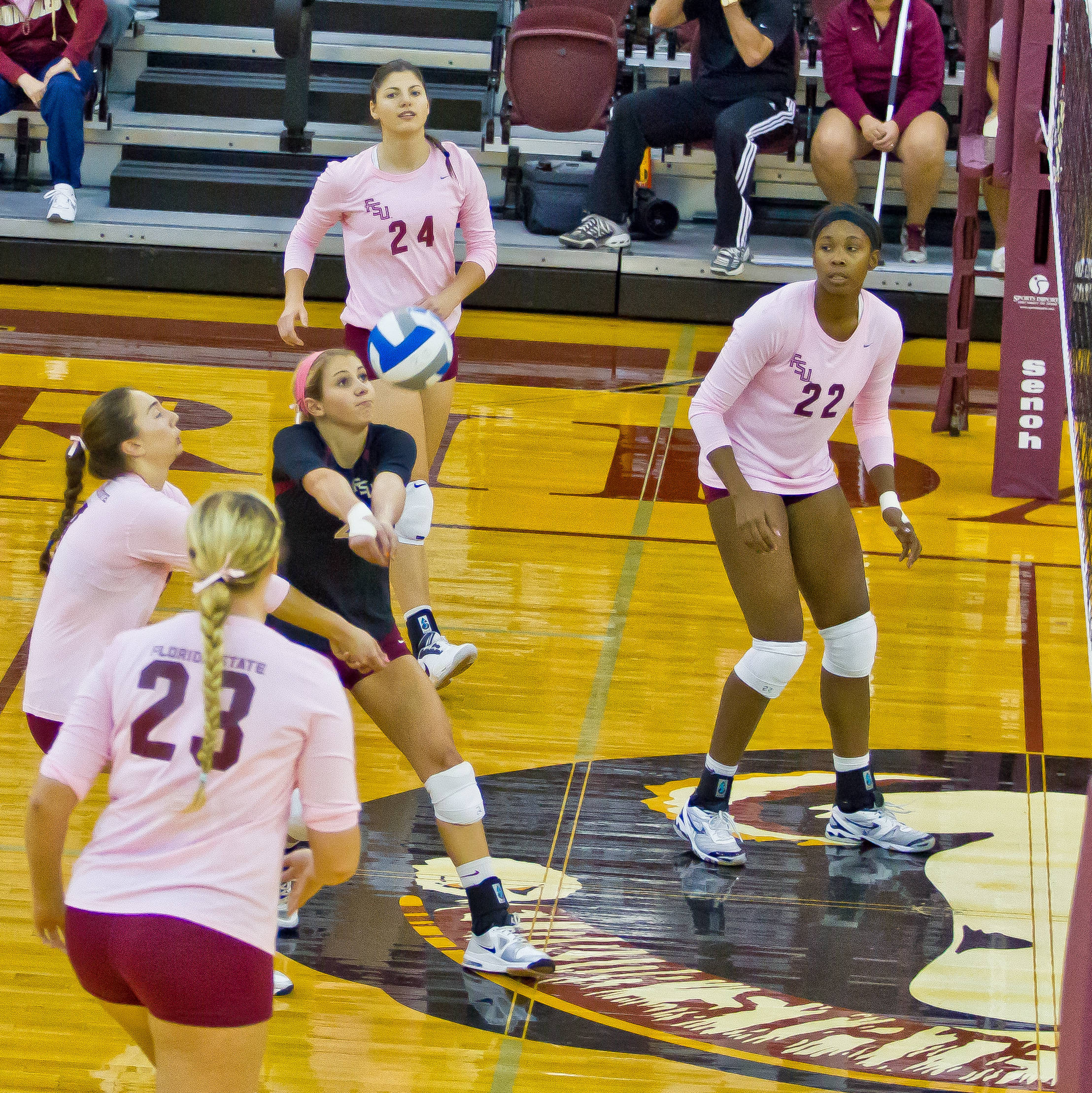 Katie Mosher (2) makes the play surrounded by Sareea Freeman (22), Elise Walch (23), Olivera Medic (24), and Fatma Yildirim (7).