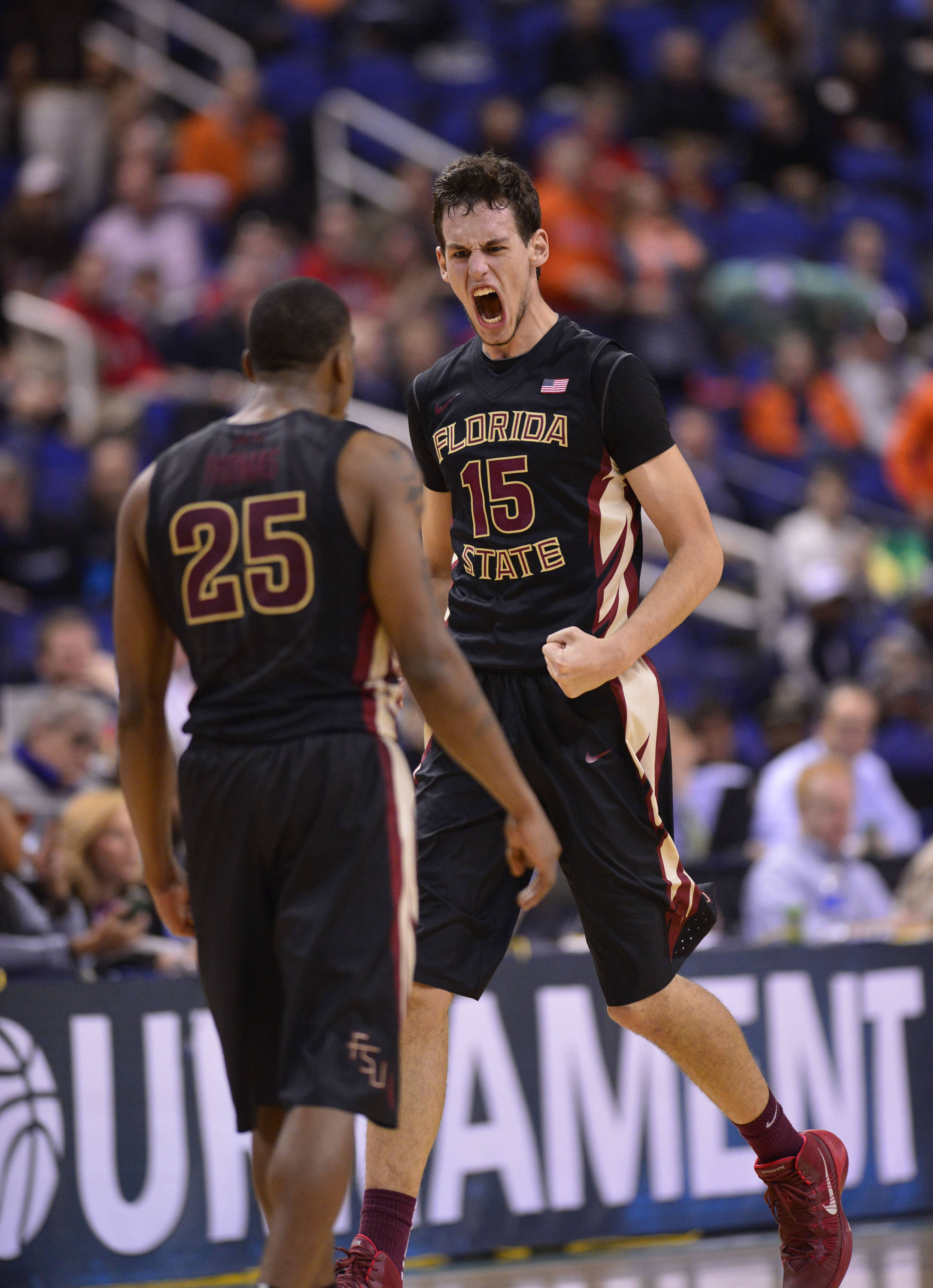 Florida State Seminoles center Boris Bojanovsky (15) reacts with guard Aaron Thomas (25) after hitting the game winning shot. The Seminoles defeated the Terrapins 67-65 in the second round of the ACC college basketball tournament at Greensboro Coliseum. Mandatory Credit: Bob Donnan-USA TODAY Sports