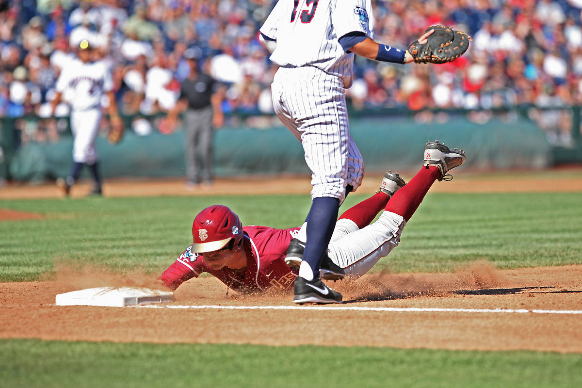 Jayce Boyd dives back to first base