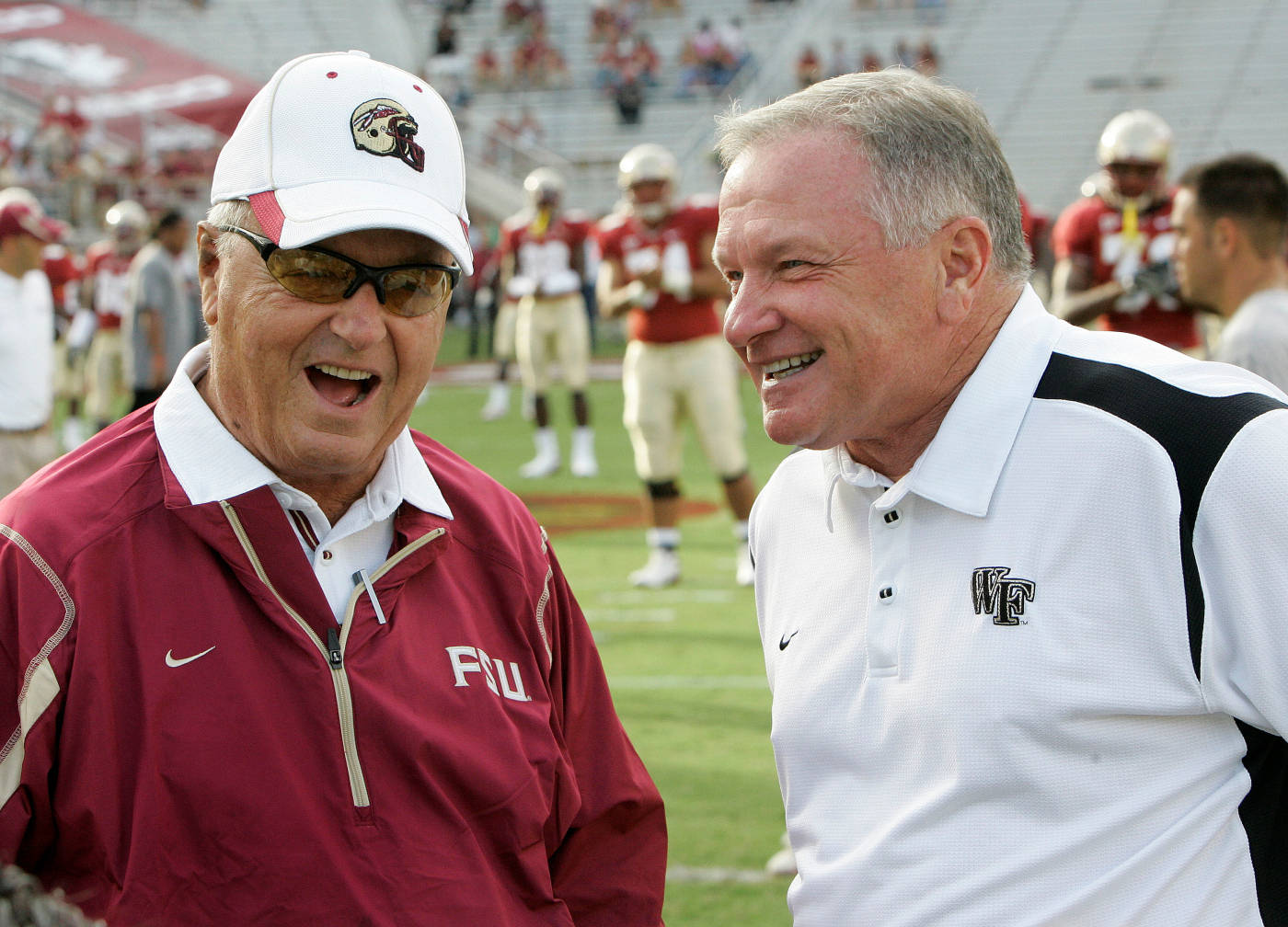Head coach Bobby Bowden and Jim Grobe share a moment before the start of the game.