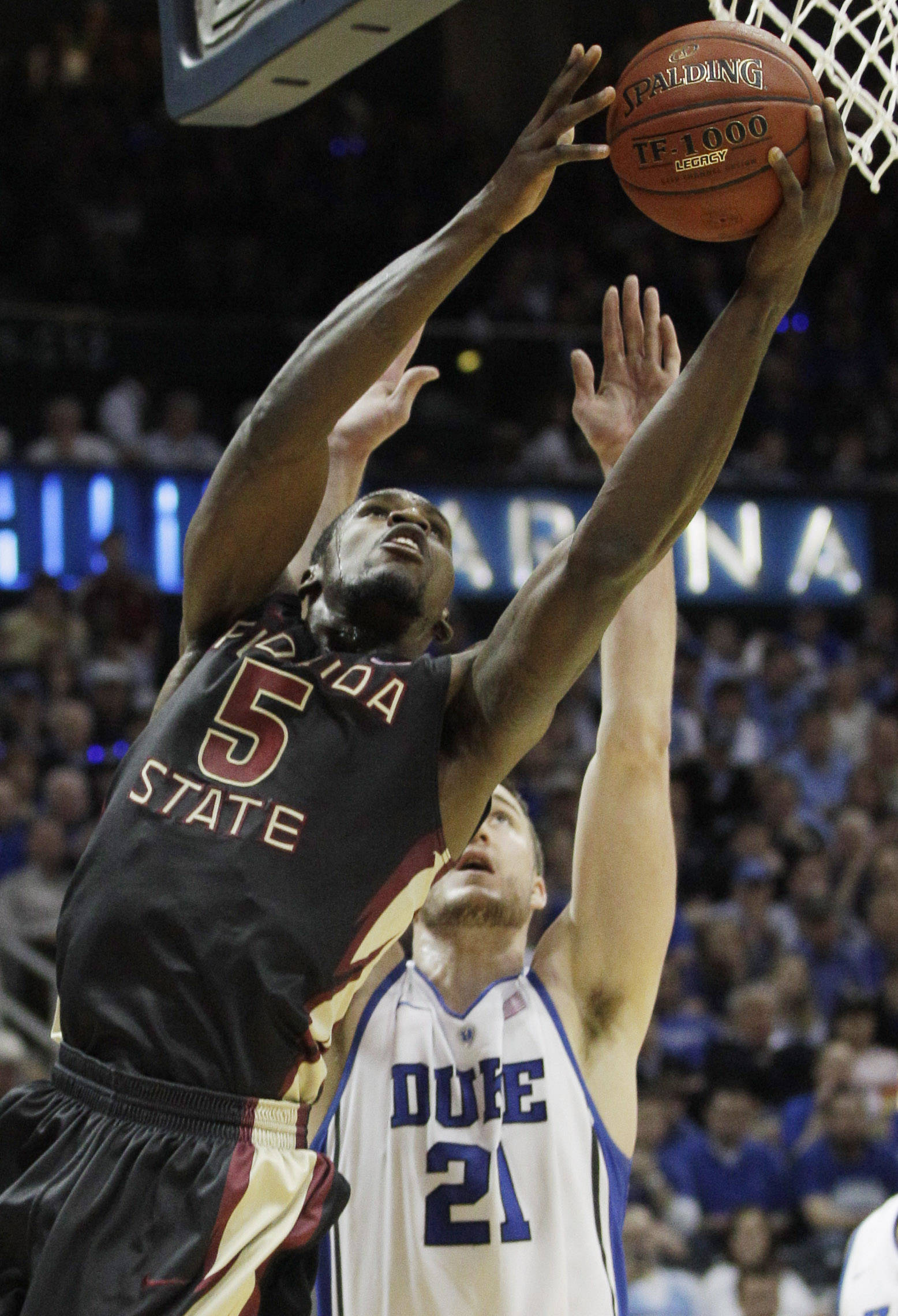 Florida State forward Bernard James (5) works against Duke forward Miles Plumlee (21) during the first half of an NCAA college basketball game in the semifinals of the Atlantic Coast Conference tournament, Saturday, March 10, 2012, in Atlanta. (AP Photo/Chuck Burton)