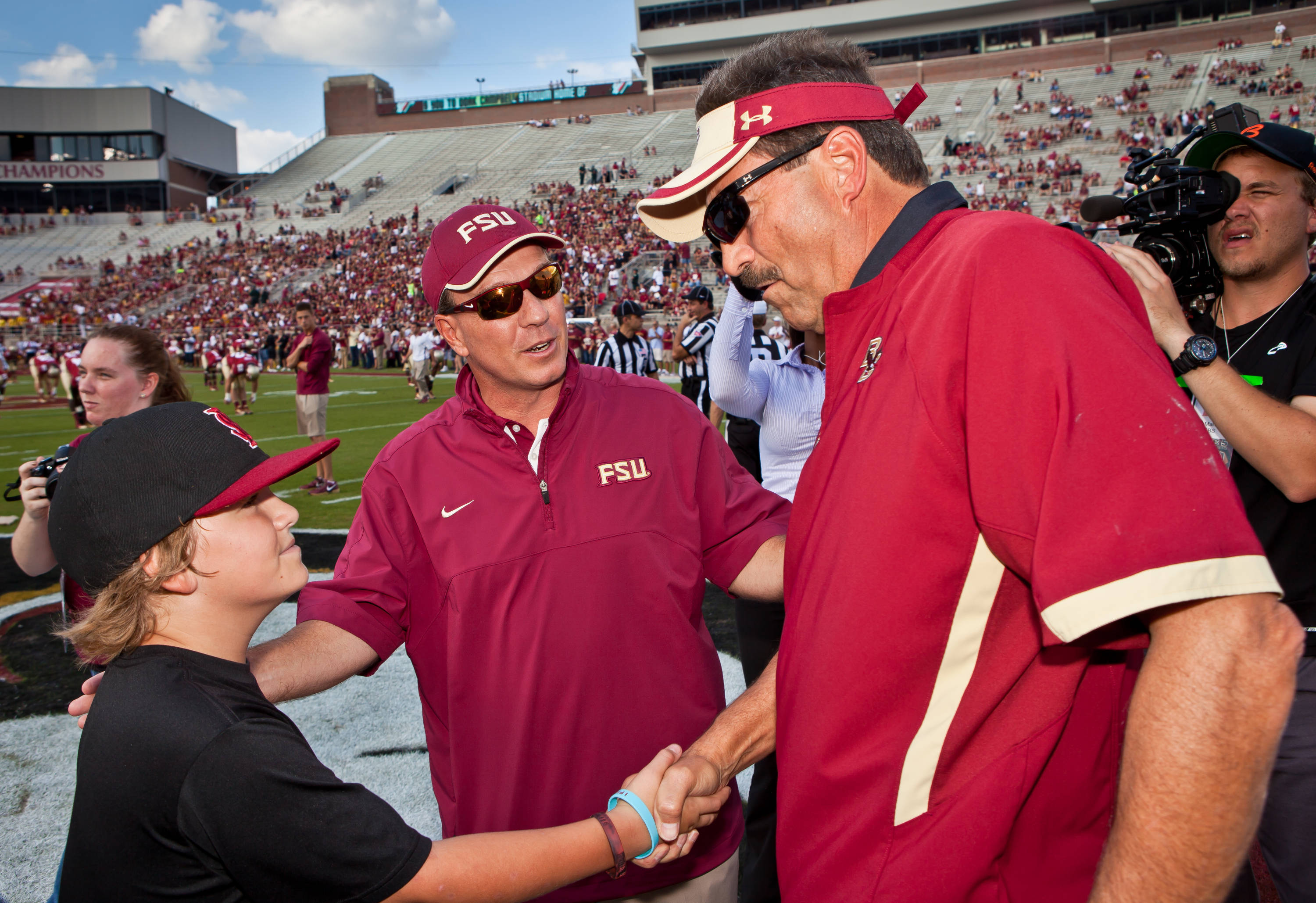 Jimbo Fisher introduces Trey Fisher to BC Coach Frank Spaziani.
