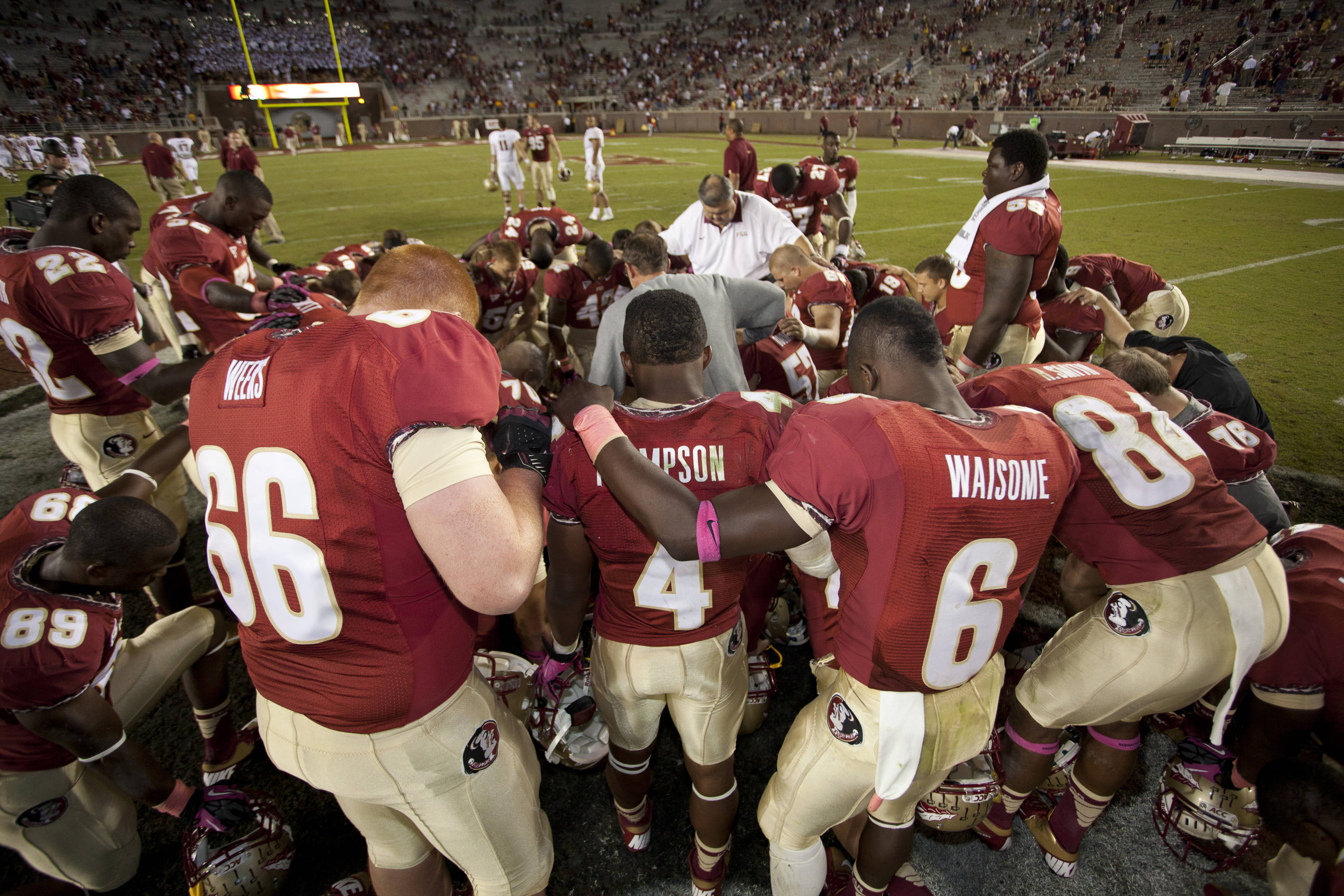 Players take a moment of quiet after the FSU vs Boston College football game on October 13, 2012 in Tallahassee, Fla.